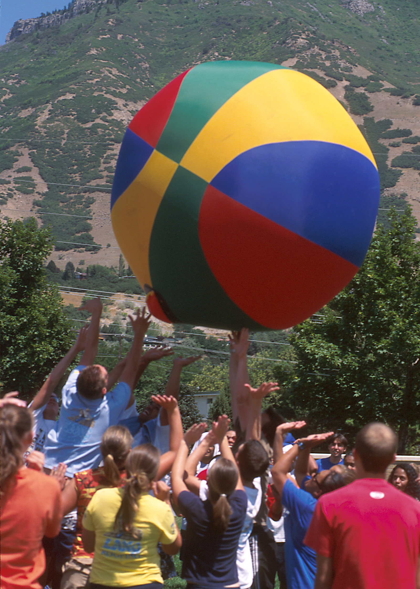 Young people play with a giant ball at Especially for Youth in 2000.