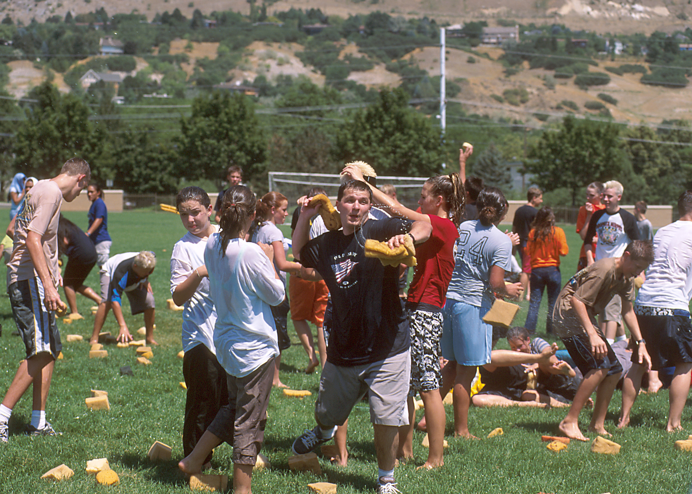 Youth engage in a water fight at Especially for Youth in 2000.