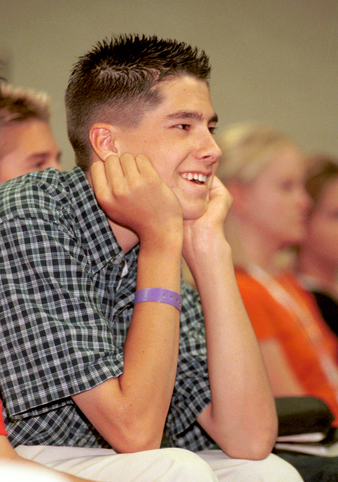 A young man listens during a class by Brad Wilcox in 2000.