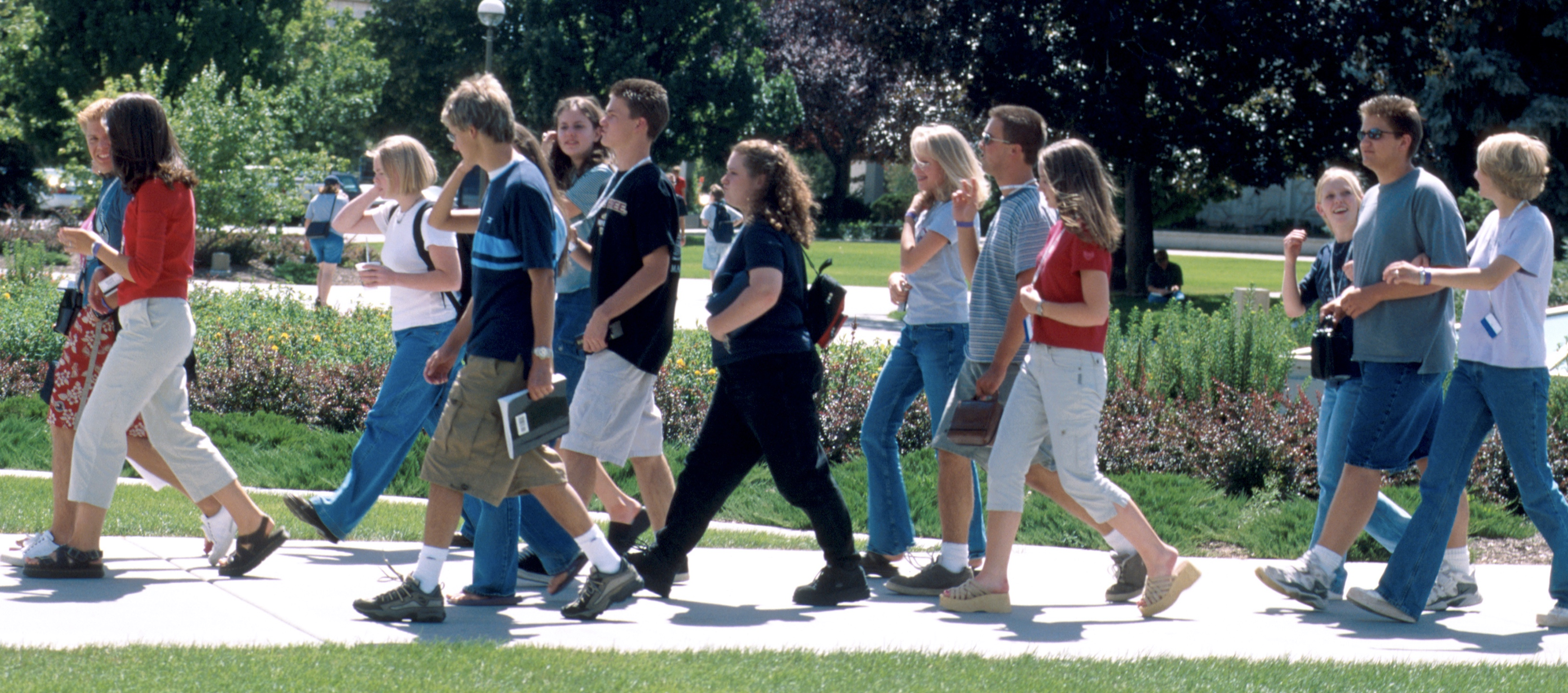 A group walks on the sidewalk together at Especially for Youth in 2000.