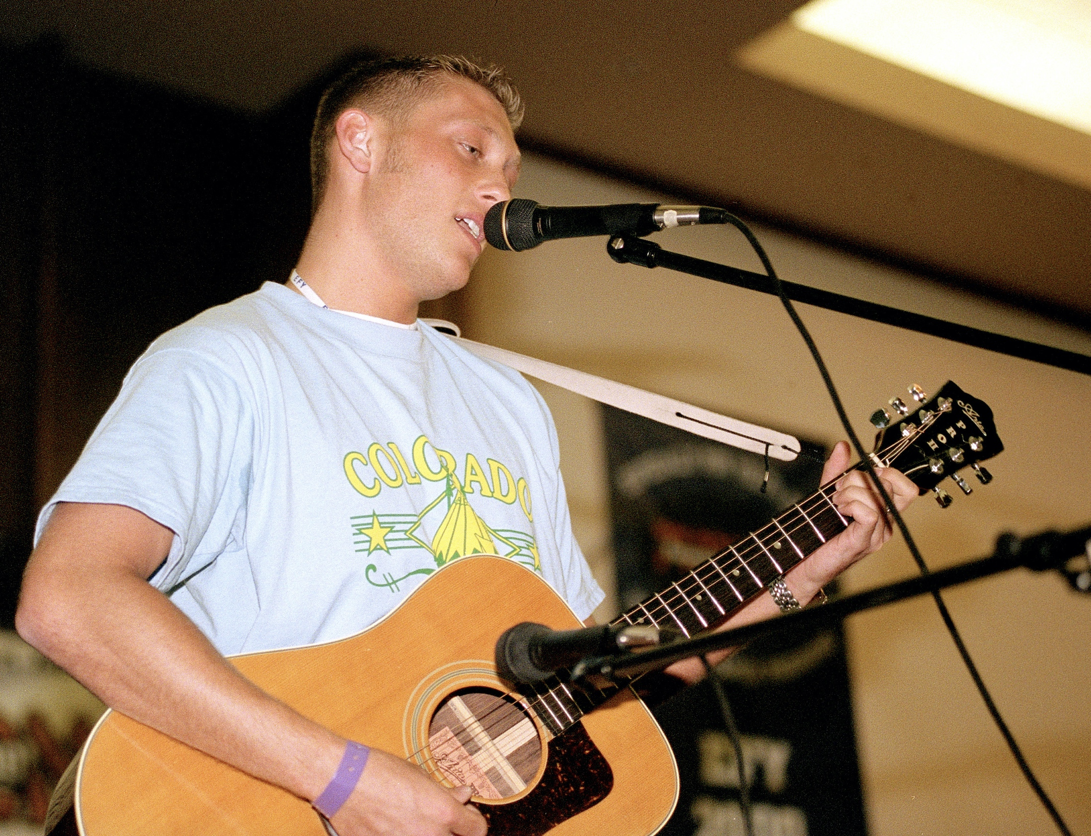 A young man plays his guitar and sings at Especially for Youth in 2000.