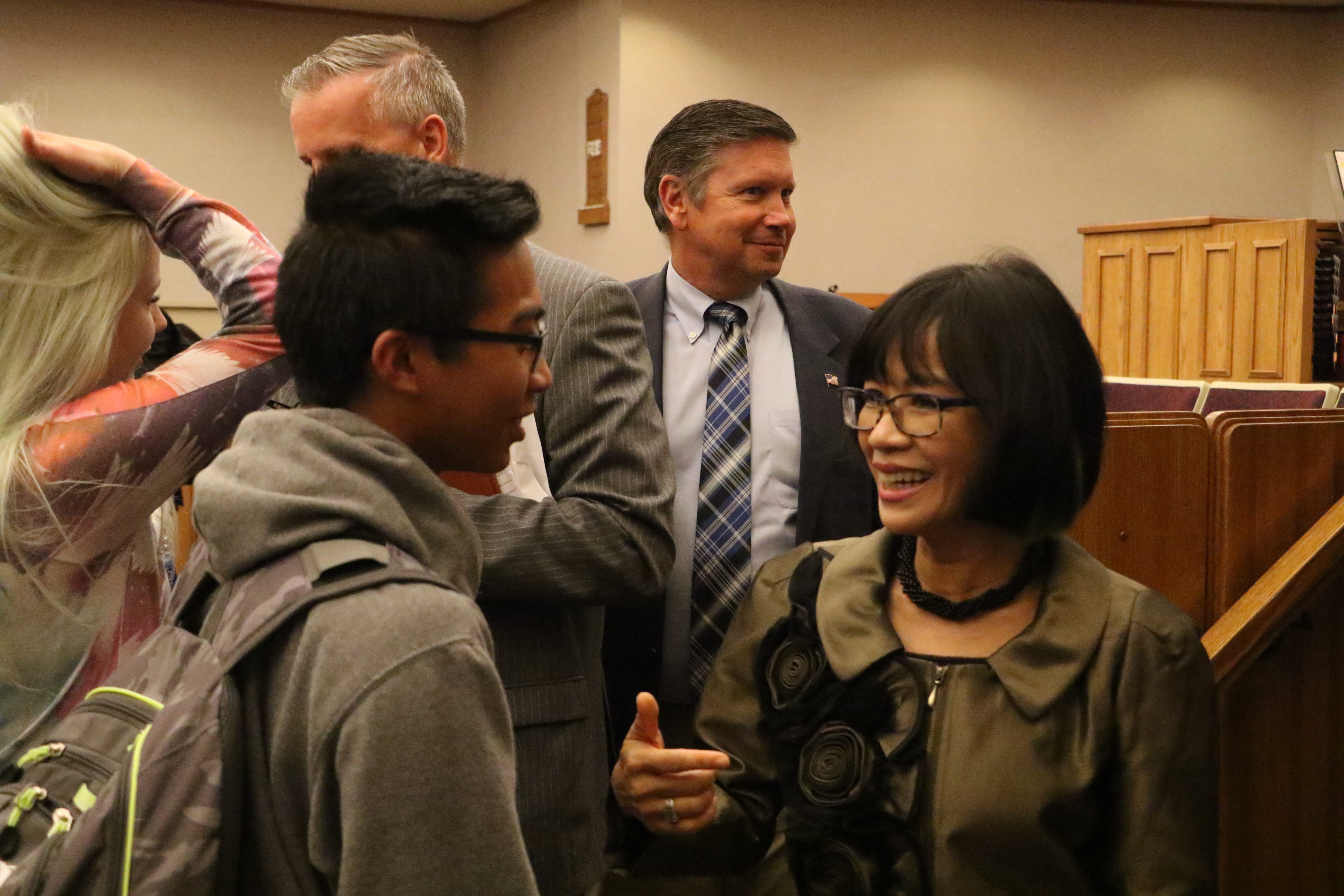 UVU President Astrid S. Tuminez speaks with students following a devotional with President M. Russell Ballard on Friday, Sept. 20, 2019.