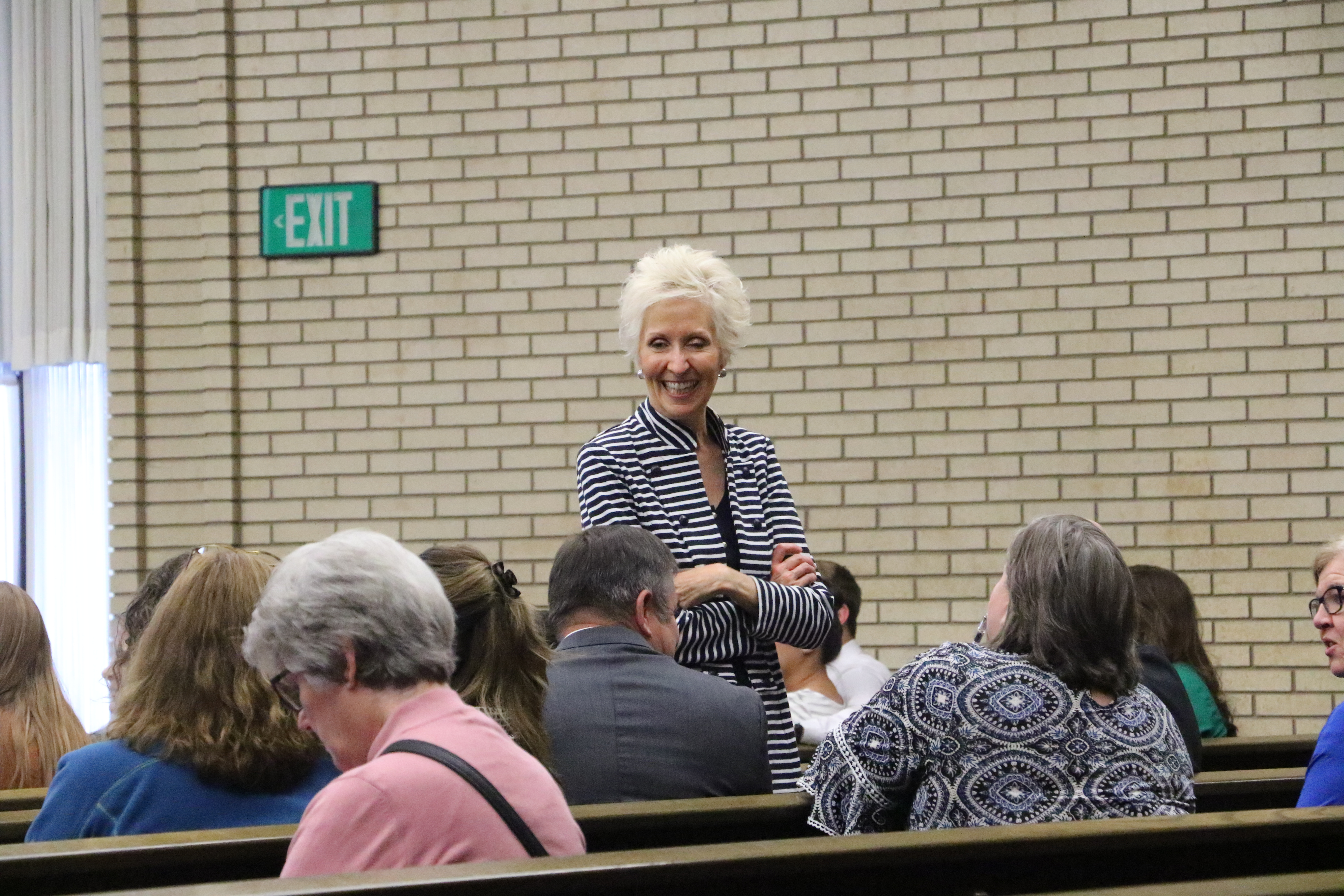 Attendees at a Sunday night devotional in Holladay, Utah, with Sister Joy D. Jones on Sept. 22, 2019 chat together prior to the devotional address.