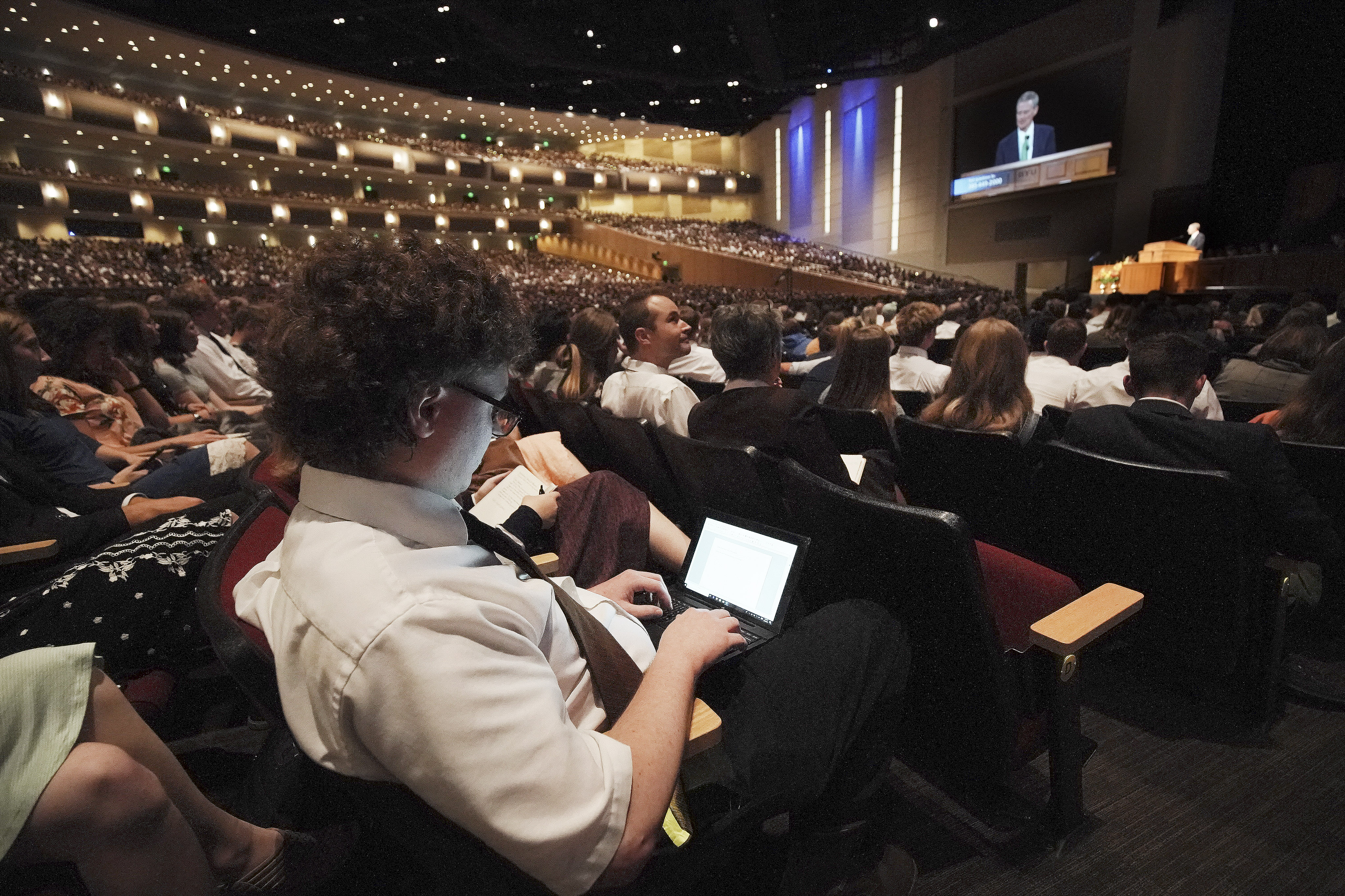 Student Joshua Elliott texts a question to Elder David A. Bednar, of the Quorum of the Twelve Apostles of The Church of Jesus Christ of Latter-day Saints, during a fireside at BYU Idaho in Rexburg on Sunday, Sept. 22, 2019.