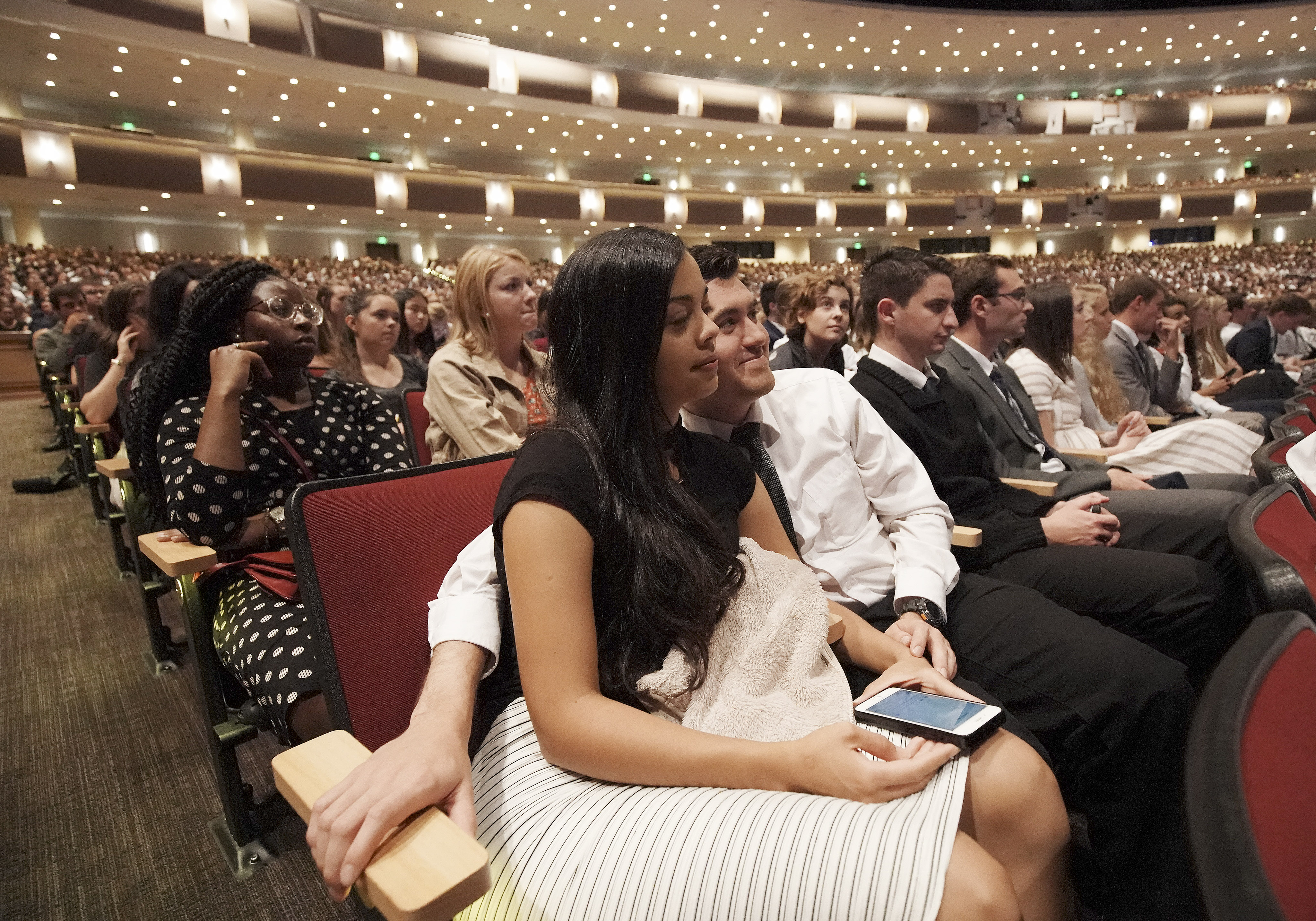 Students Larissa Cunha and Hector Rascon listen to Elder David A. Bednar, of the Quorum of the Twelve Apostles of The Church of Jesus Christ of Latter-day Saints, and his wife, Sister Susan Bednar, speak during a fireside at BYU Idaho in Rexburg on Sunday, Sept. 22, 2019.