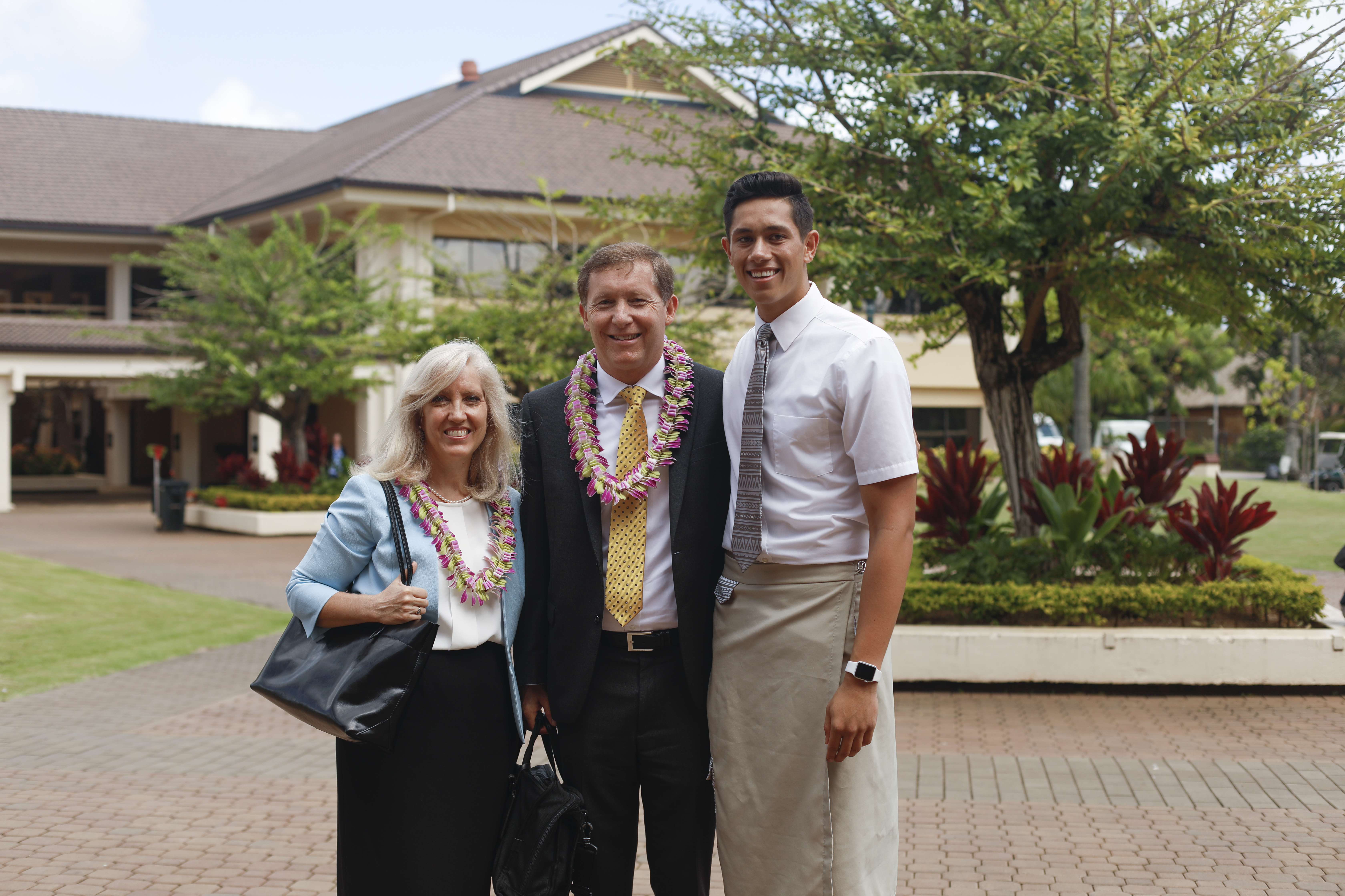 Elder L. Todd Budge and his wife, Lori, stand with their nephew, Jensen Ama, at BYU-Hawaii following Elder Budge's devotional address on Tuesday, Sept. 24, 2019.