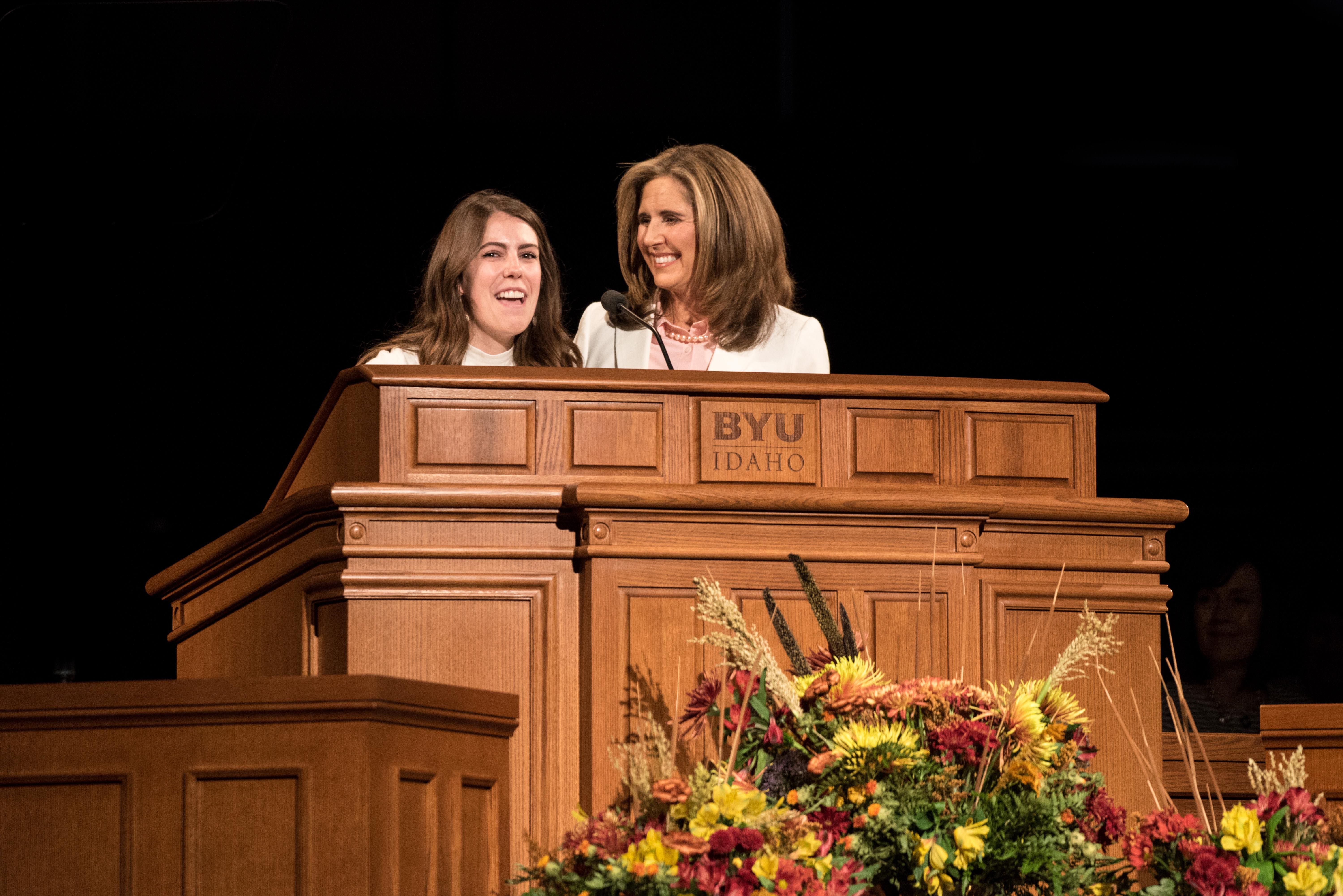 Standing next to Sister Kelly Eyring, a student shares an insight with the audience at Devotional in the BYU-Idaho Center on September 24, 2019.
