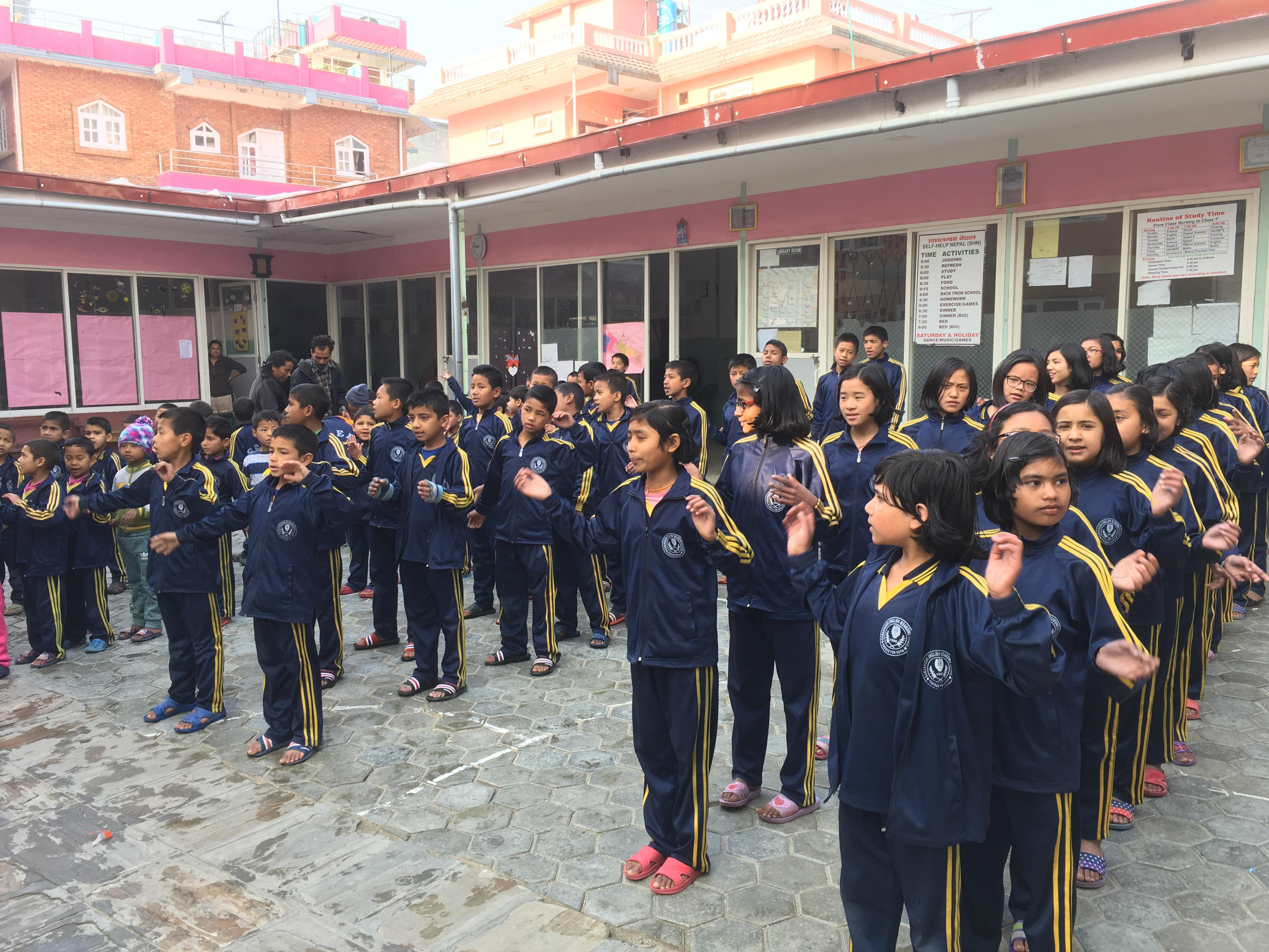 Children at Home of Hope in Kathmandu, Nepal gather in the courtyard for their morning routines before school.