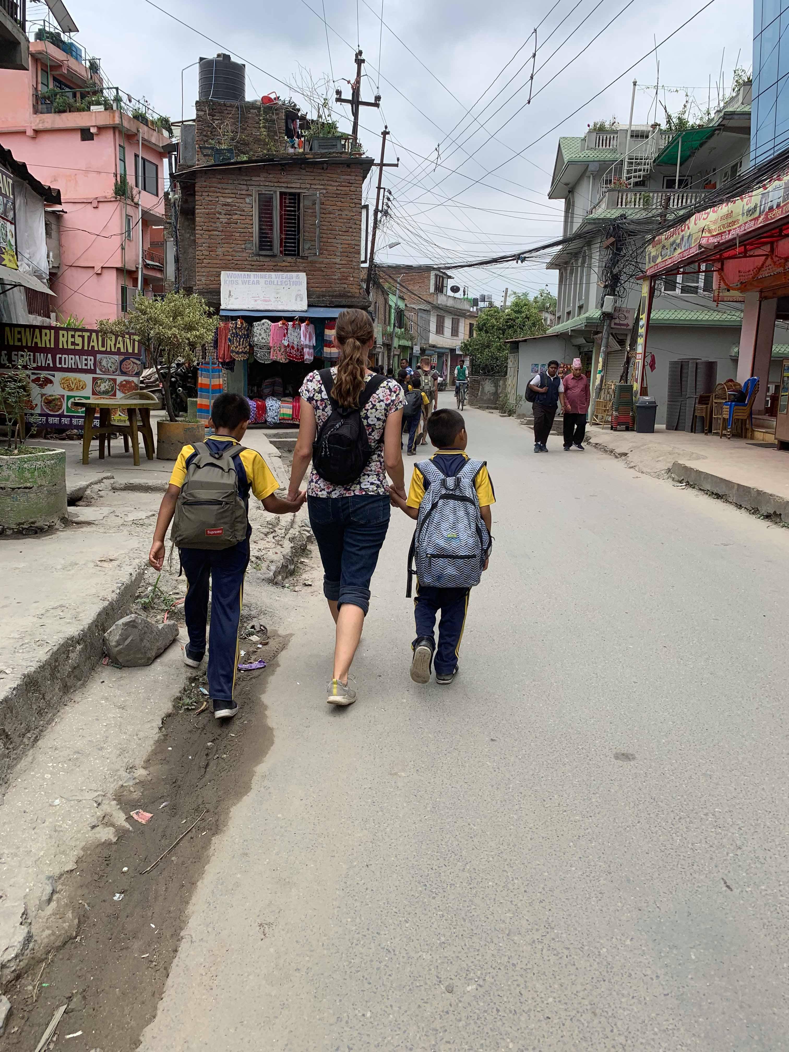 Self Help Nepal volunteer Dani Edgar walks with children from Home of Hope in Kathmandu, Nepal.