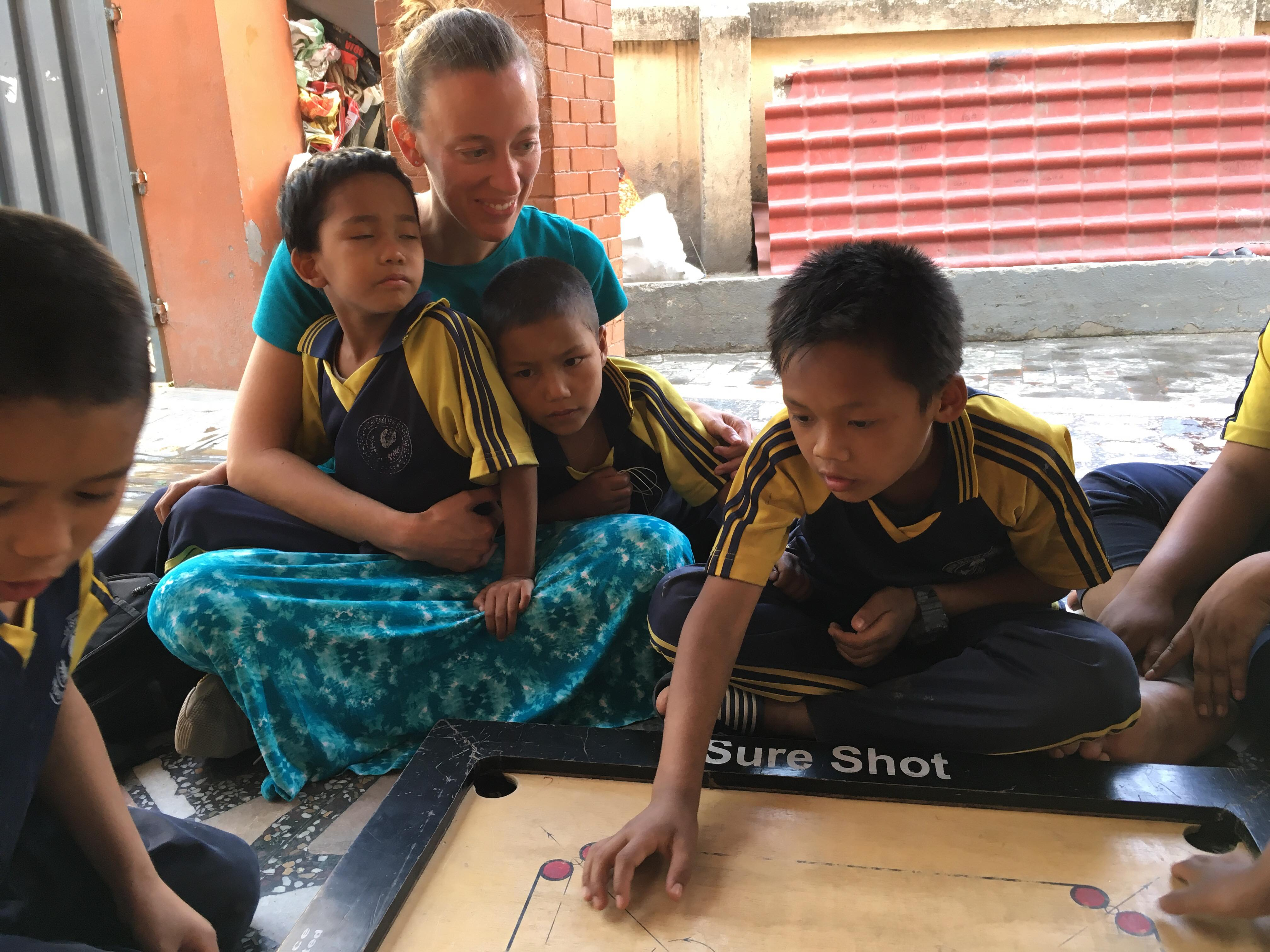 Self Help Nepal volunteer Dani Edgar plays a game with some of the children at Home of Hope in Kathmandu, Nepal.