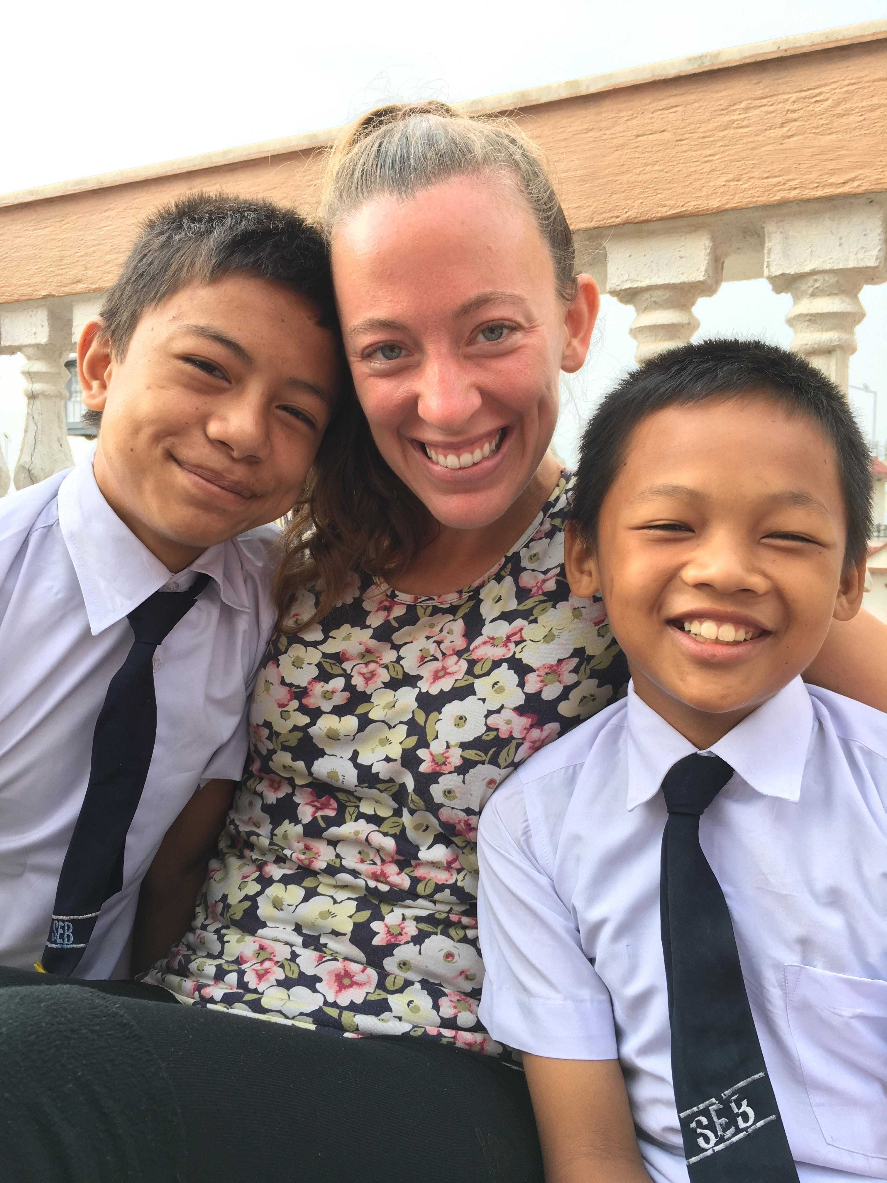 Self Help Nepal volunteer Dani Edgar poses with some of the children from Home of Hope in Kathmandu, Nepal.