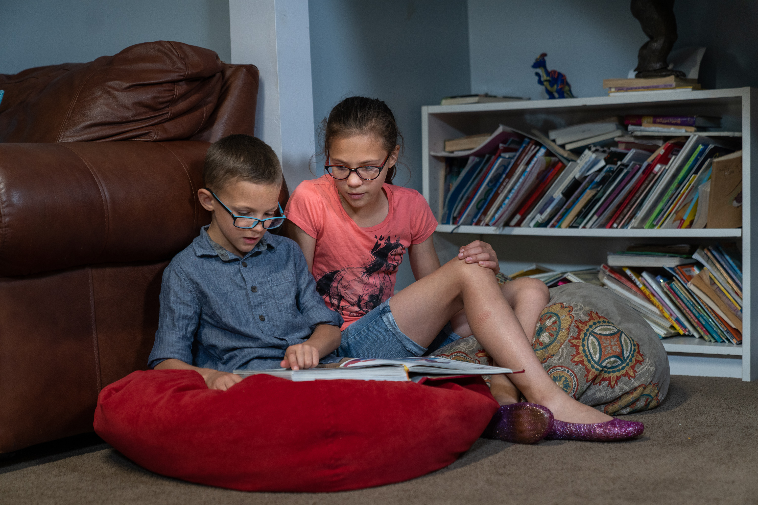 Peter, a 9-year-old from a pilot stake in Columbus, Ohio, reads aloud with his sister. As part of the Children and Youth program, Peter set a goal to pass his reading test at school.