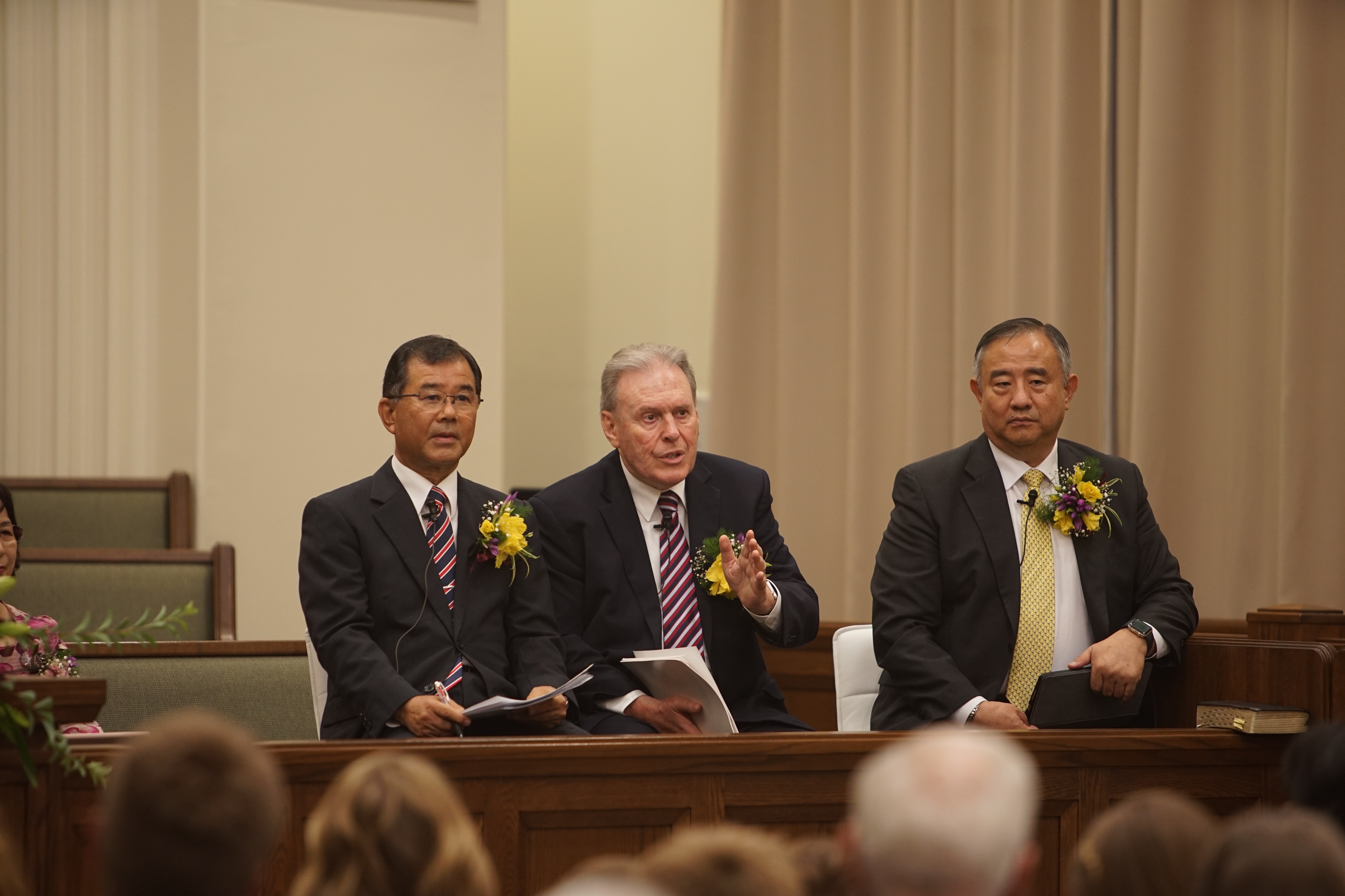 Elder Terence M. Vinson, center, and Elder Yoon Hwan Choi, right, participate in a member devotional in Okinawa, Japan, on Aug. 30, 2019.