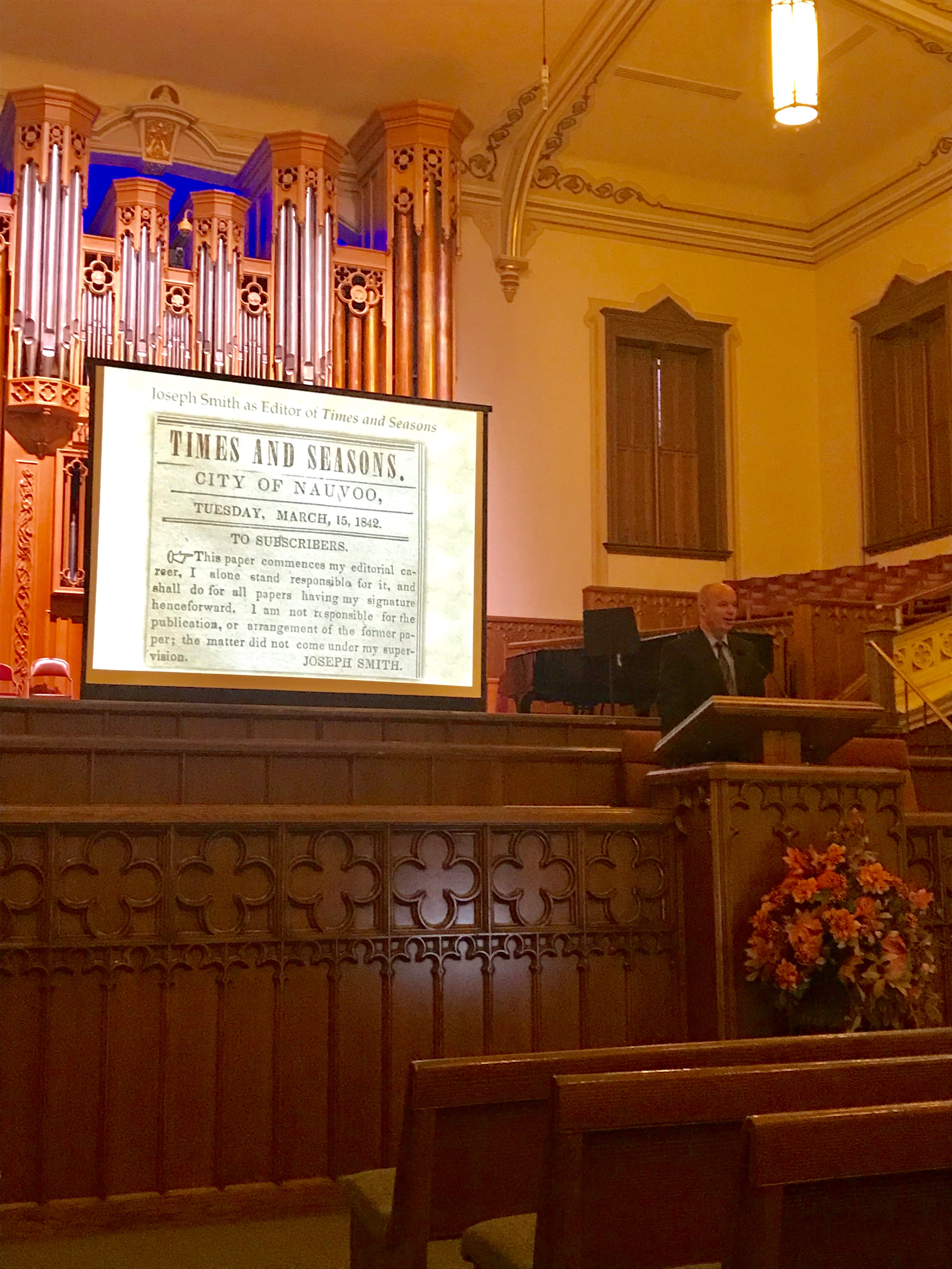 "Alex D. Smith, an editor for ""Documents, Vol. 9"" speaks during a lecture on Joseph Smith's roles in Nauvoo in 1842 on Thursday, Sept. 26, at the Assembly Hall in Salt Lake City."