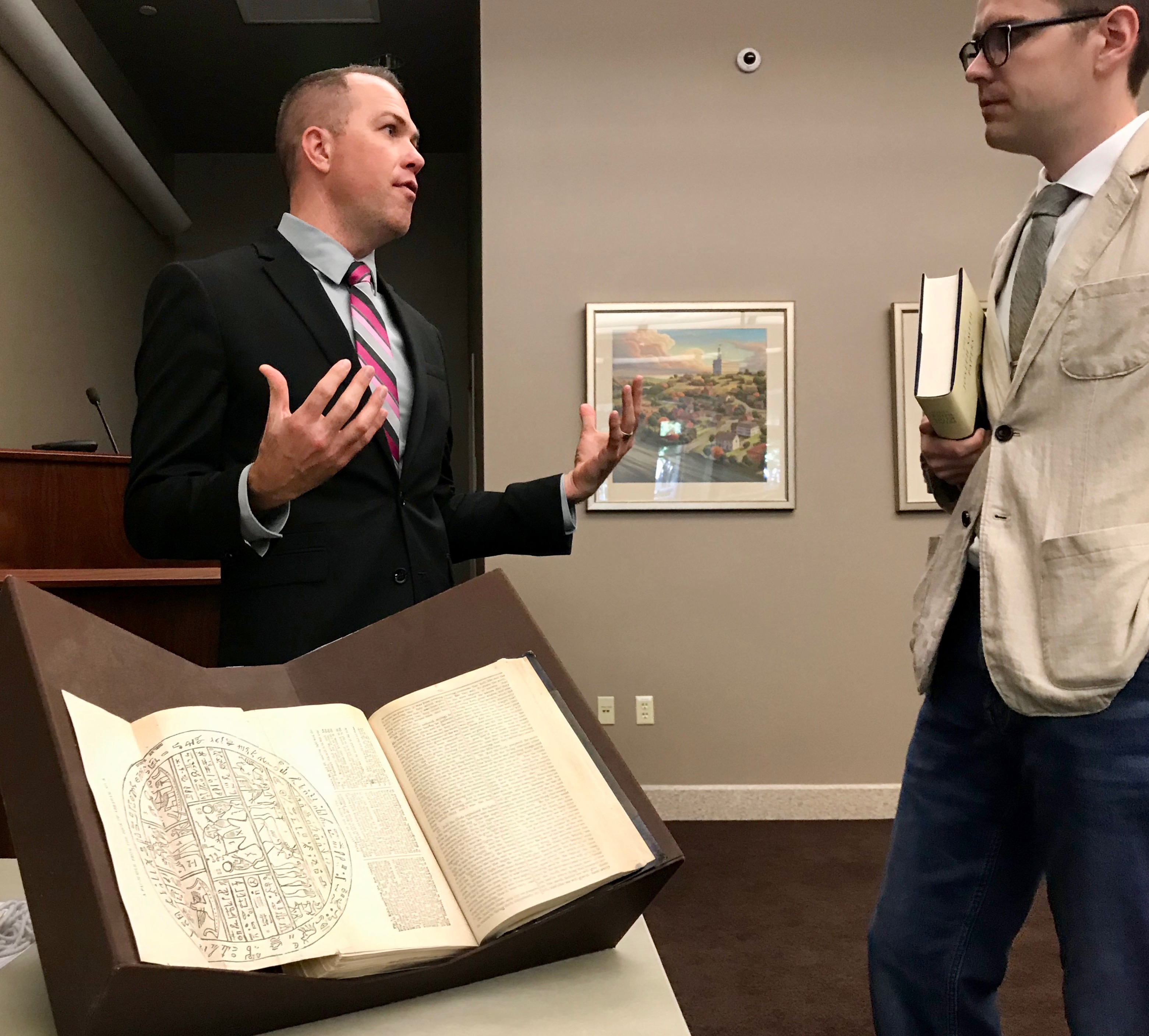 "Left, Christian K. Heimburger, an editor with the Joseph Smith Papers project, speaks with a blogger about ""Documents, Vol. 9: December 1841-April 1842."""
