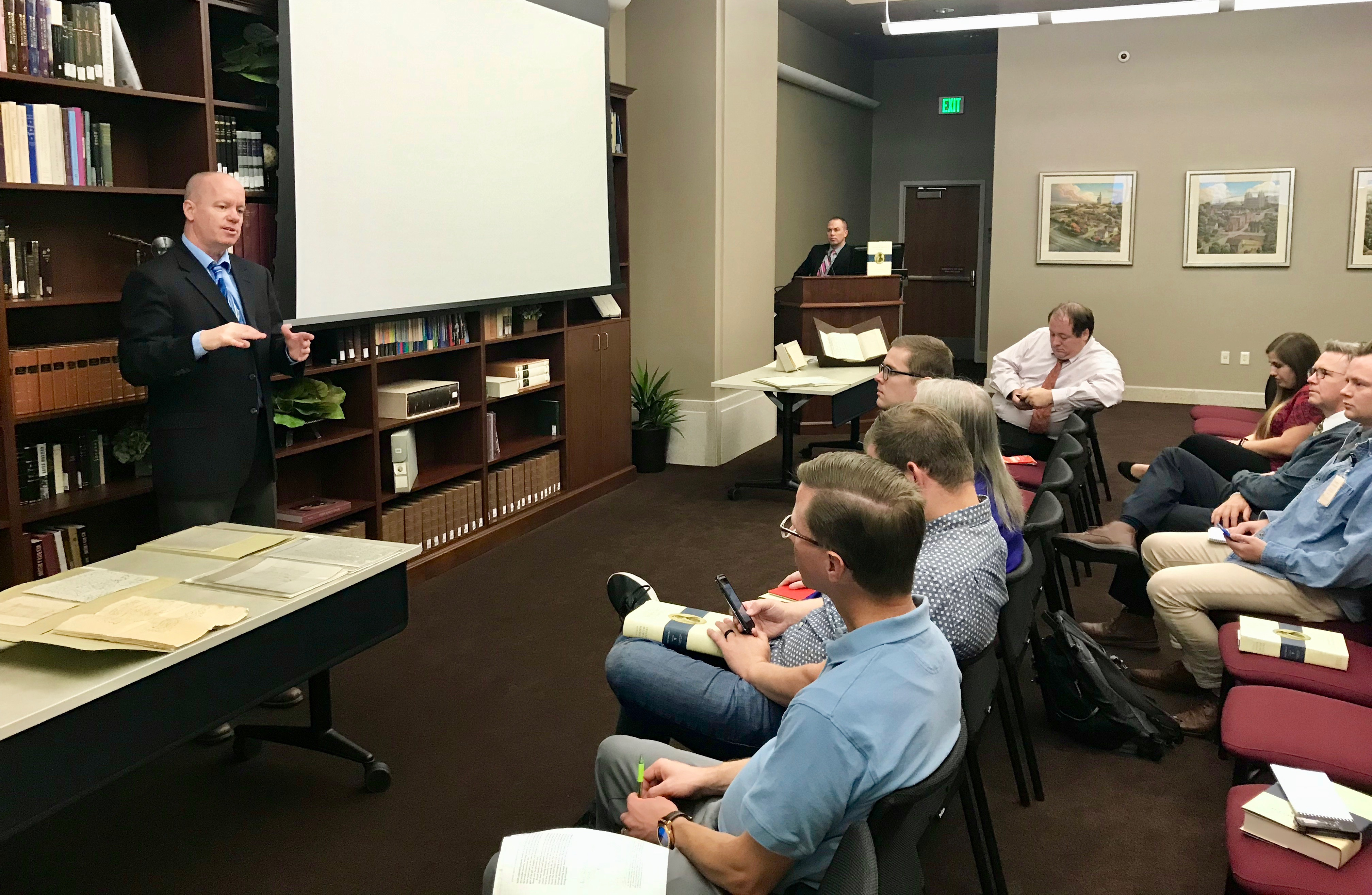 "Left, Alex D. Smith, an editor with the Joseph Smith Papers project, speaks to reporters and bloggers about ""Documents, Vol. 9: December 1841-April 1842."""