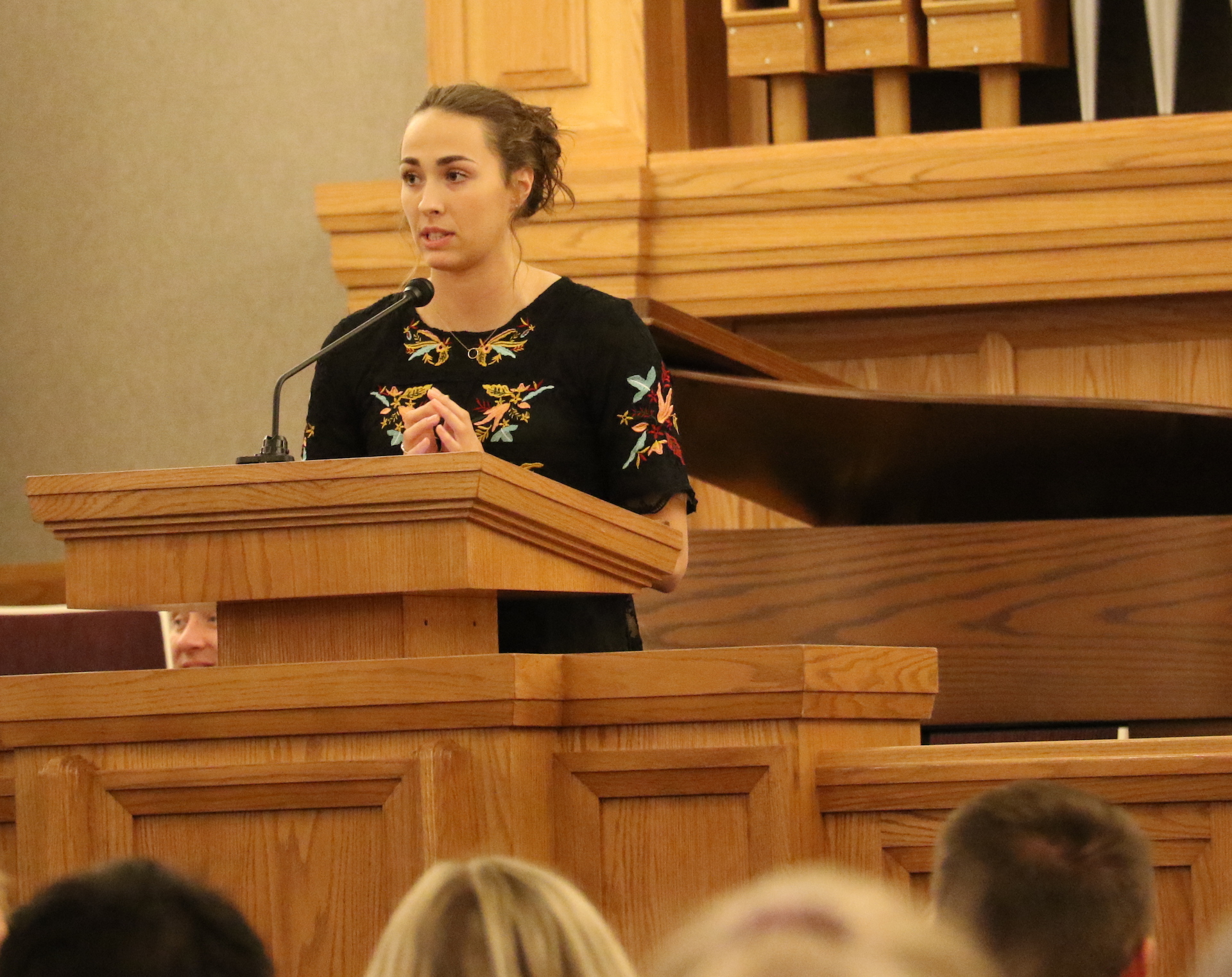 Swimmer and returned missionary McKenna Gassaway speaks at the Sept. 27, 2019, athlete devotional at the Institute of Religion at the University of Utah.