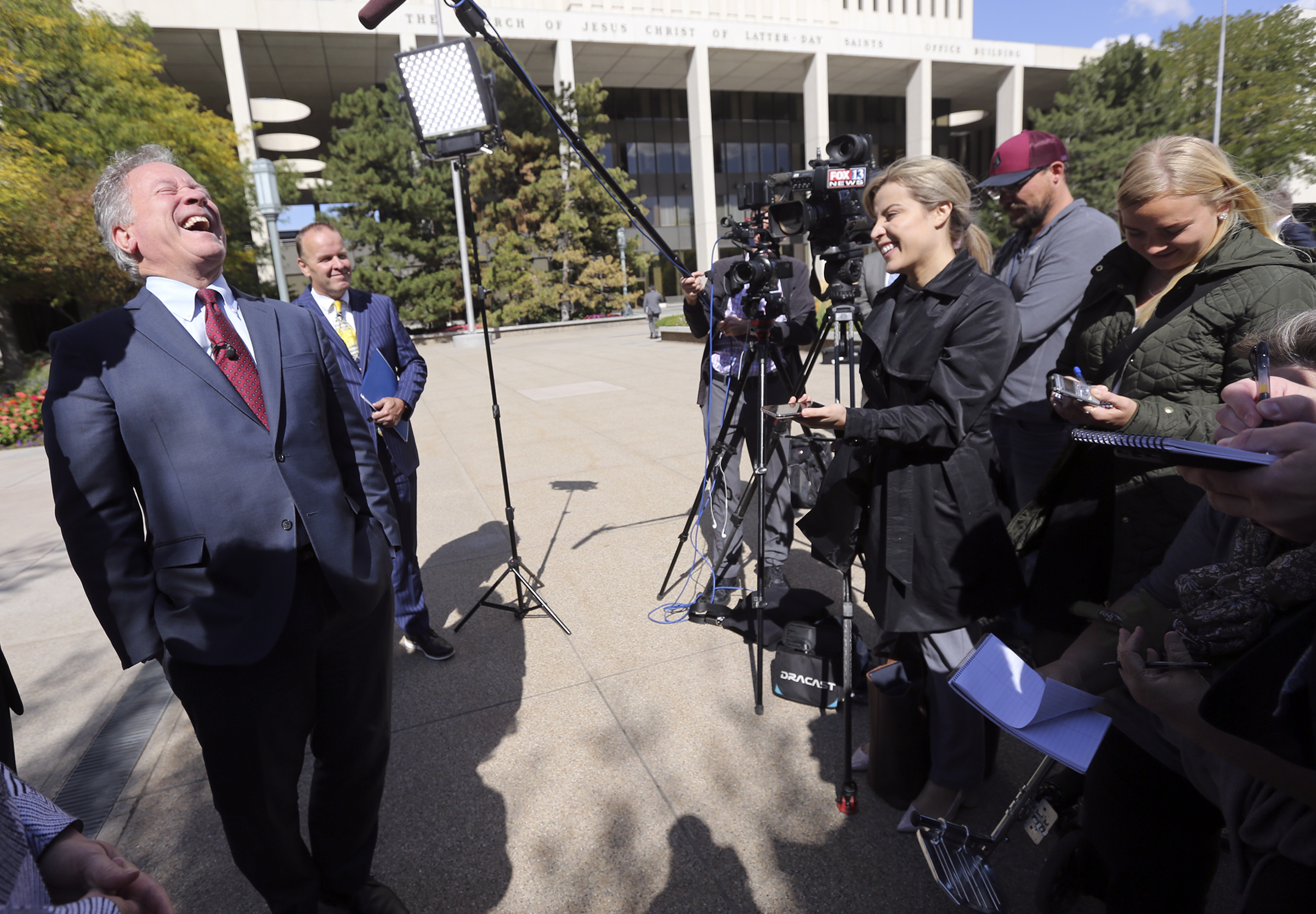 David Beasley, United Nations World Food Programme executive director, laughs while talking to members of the media outside the Church Office Building in Salt Lake City on Monday, Sept. 30, 2019.
