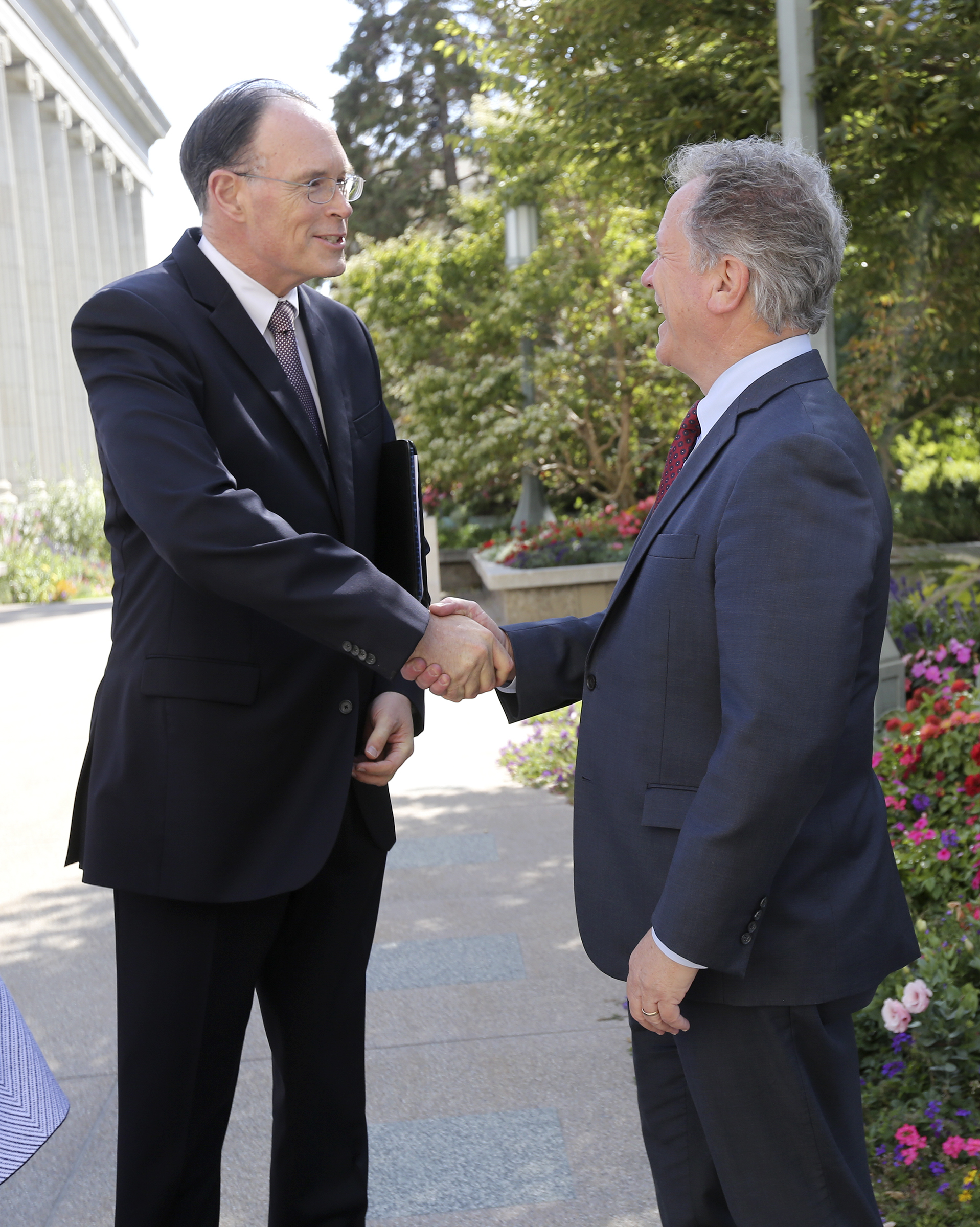 Bishop W. Christopher Waddell, second counselor in the Presiding Bishopric of The Church of Jesus Christ of Latter-day Saints, shakes hands with David Beasley, United Nations World Food Programme executive director, after they talked with members of the media at Temple Square in Salt Lake City on Monday, Sept. 30, 2019.