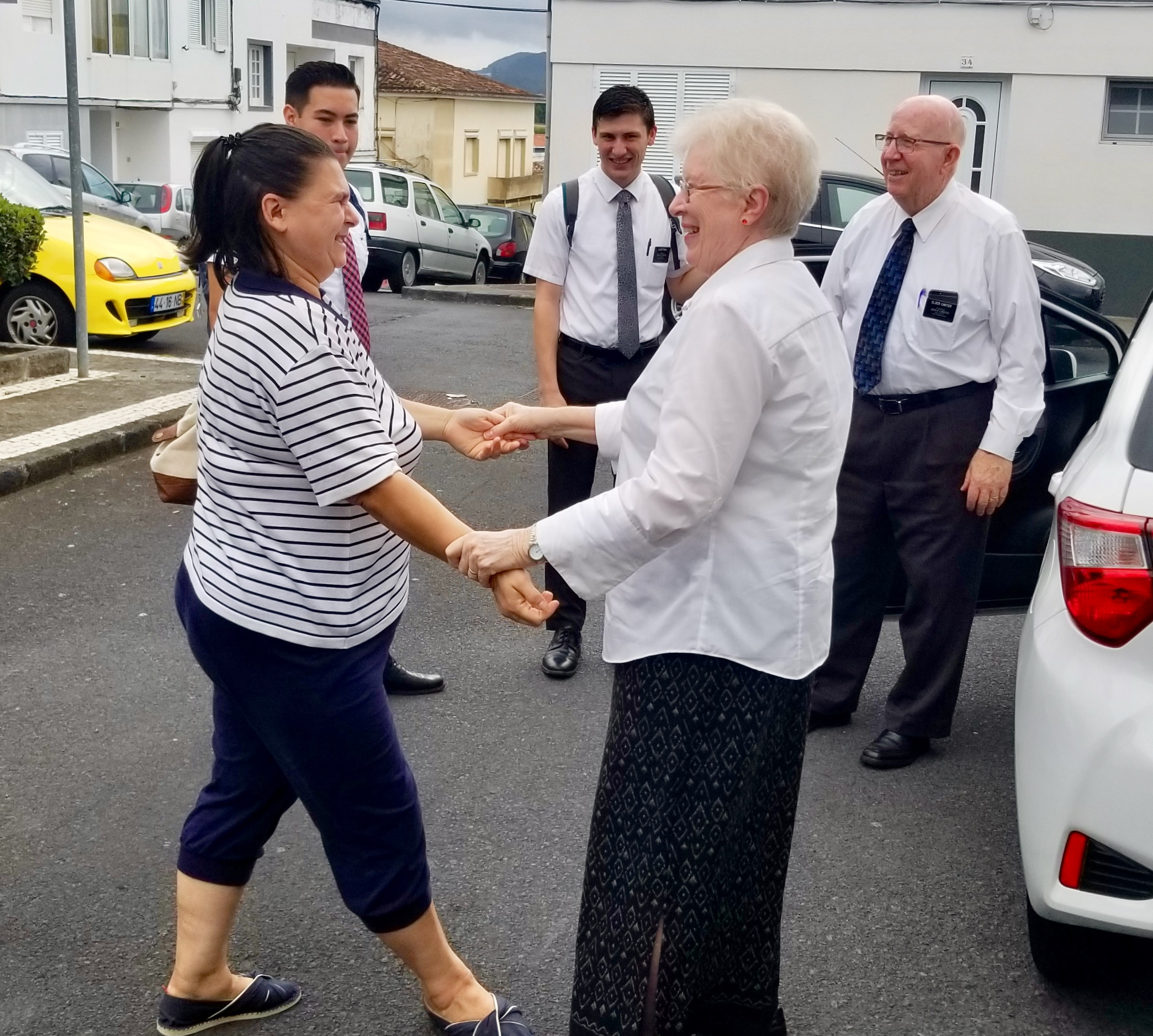Lúcia Días, a recent convert of the Ponta Delgada Branch on the Azores' São Miguel Island, greets Sister Louise Carter on the street on Sept. 17, 2019. Behind them, from right to left, Elder Robert V. Carter, Elder Matthew Ethan Rhea and Elder Jimmy Terron.