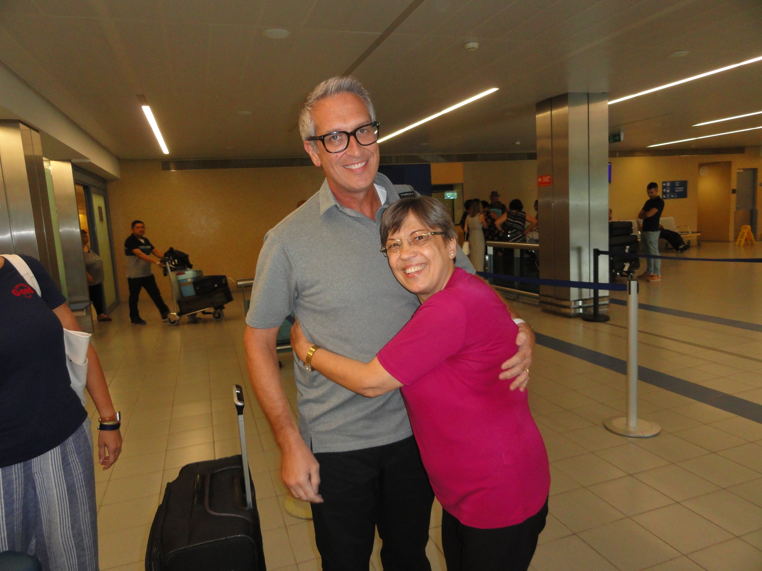 Nair Alves, right, greets Ben Clonts, one of the missionaries who helped teach and baptize the Alves family in 1985, at the Lajes Airport on the Azores' Terceira Island on Sept. 18, 2019.