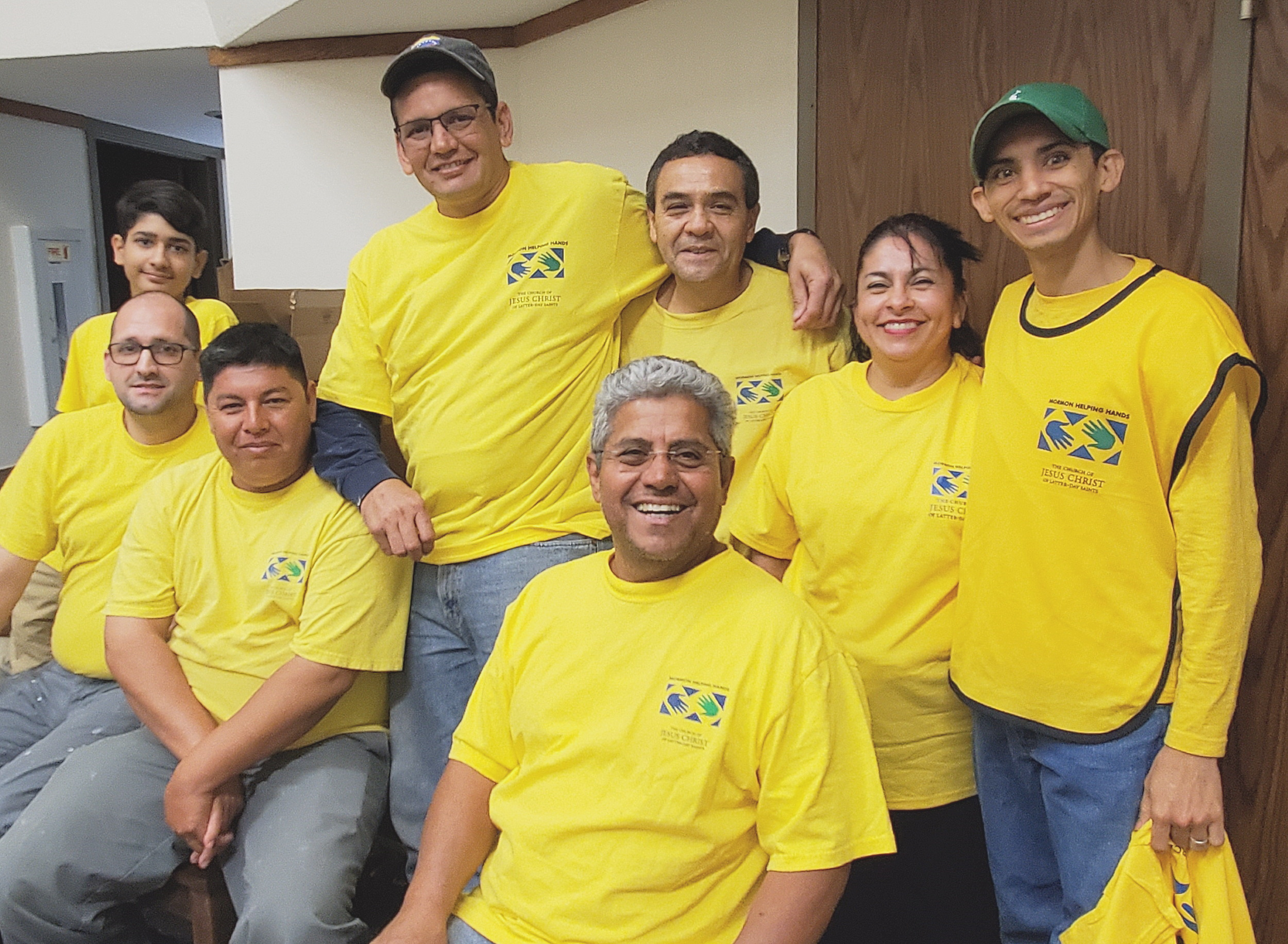 Members of the Houston 4th and 8th Spanish Wards don yellow shirts to volunteer and help those in need.