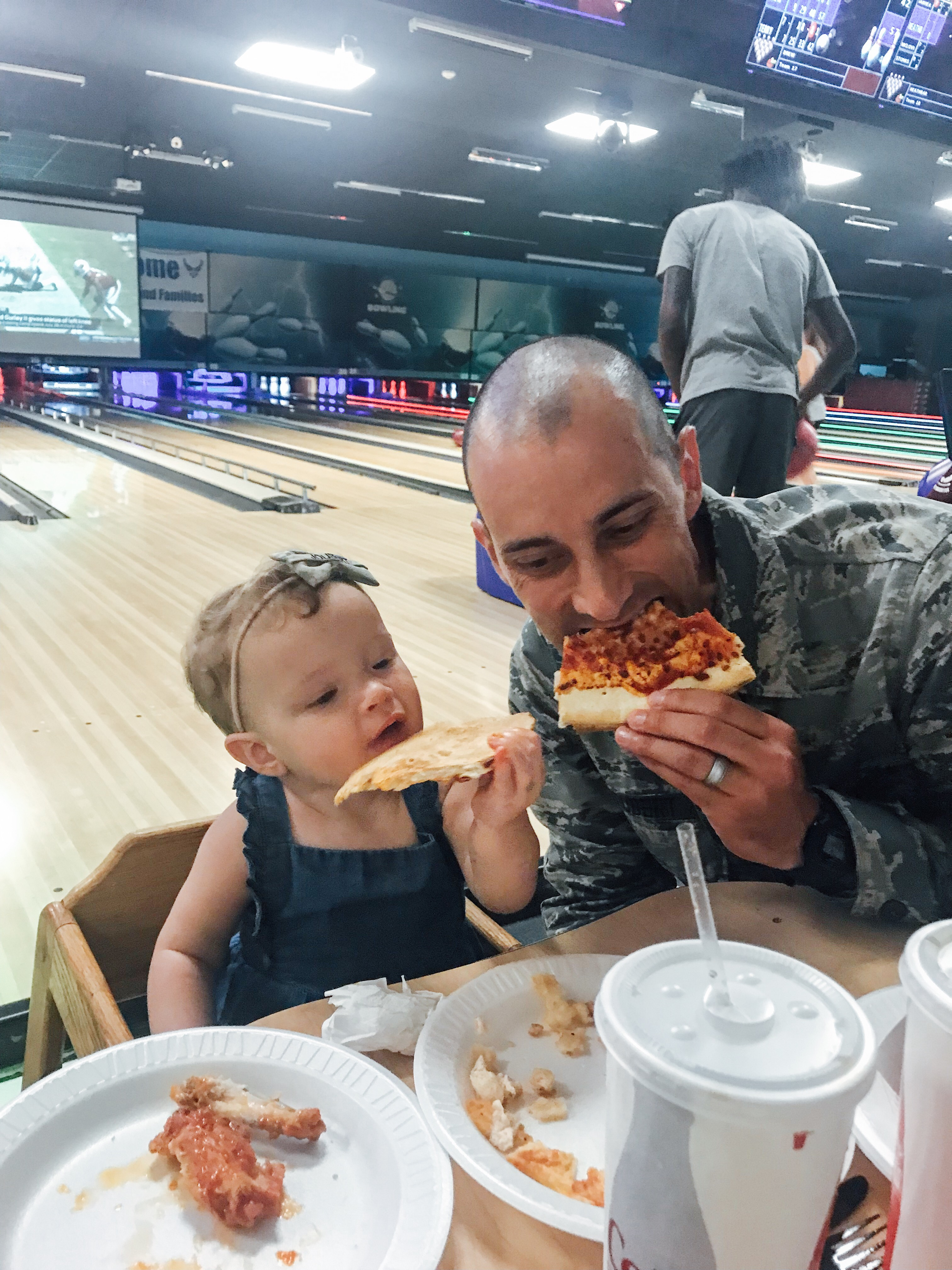 Cristian Joubert enjoys a slice of pizza with his daughter, Jemma, following his July, 2019, graduation from U.S. Air Force basic training in San Antonio, Texas.