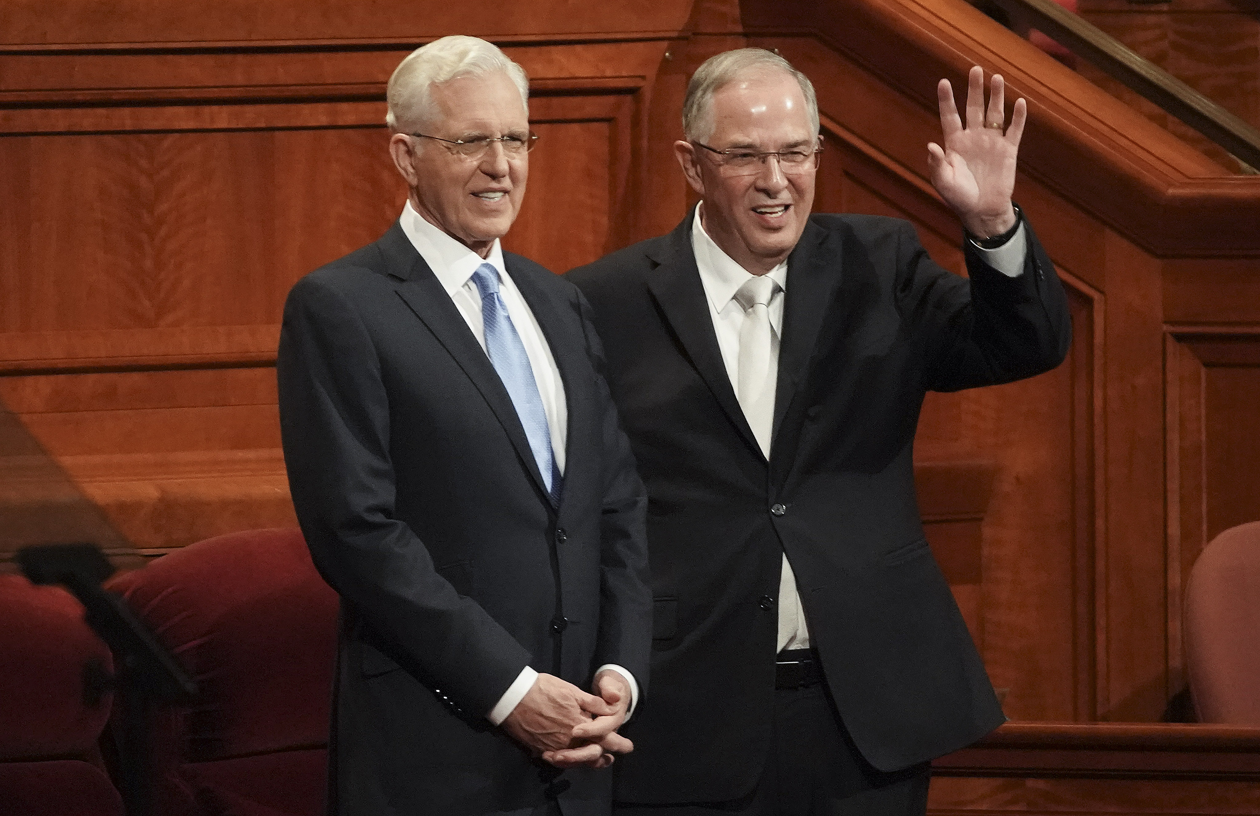 Elder D. Todd Christofferson, left, and Elder Neil L. Andersen of the Quorum of the Twelve Apostles wave to conferencegoers prior to the Saturday morning session of the 189th Semiannual General Conference of The Church of Jesus Christ of Latter-day Saints in Salt Lake City on Saturday, Oct. 5, 2019.