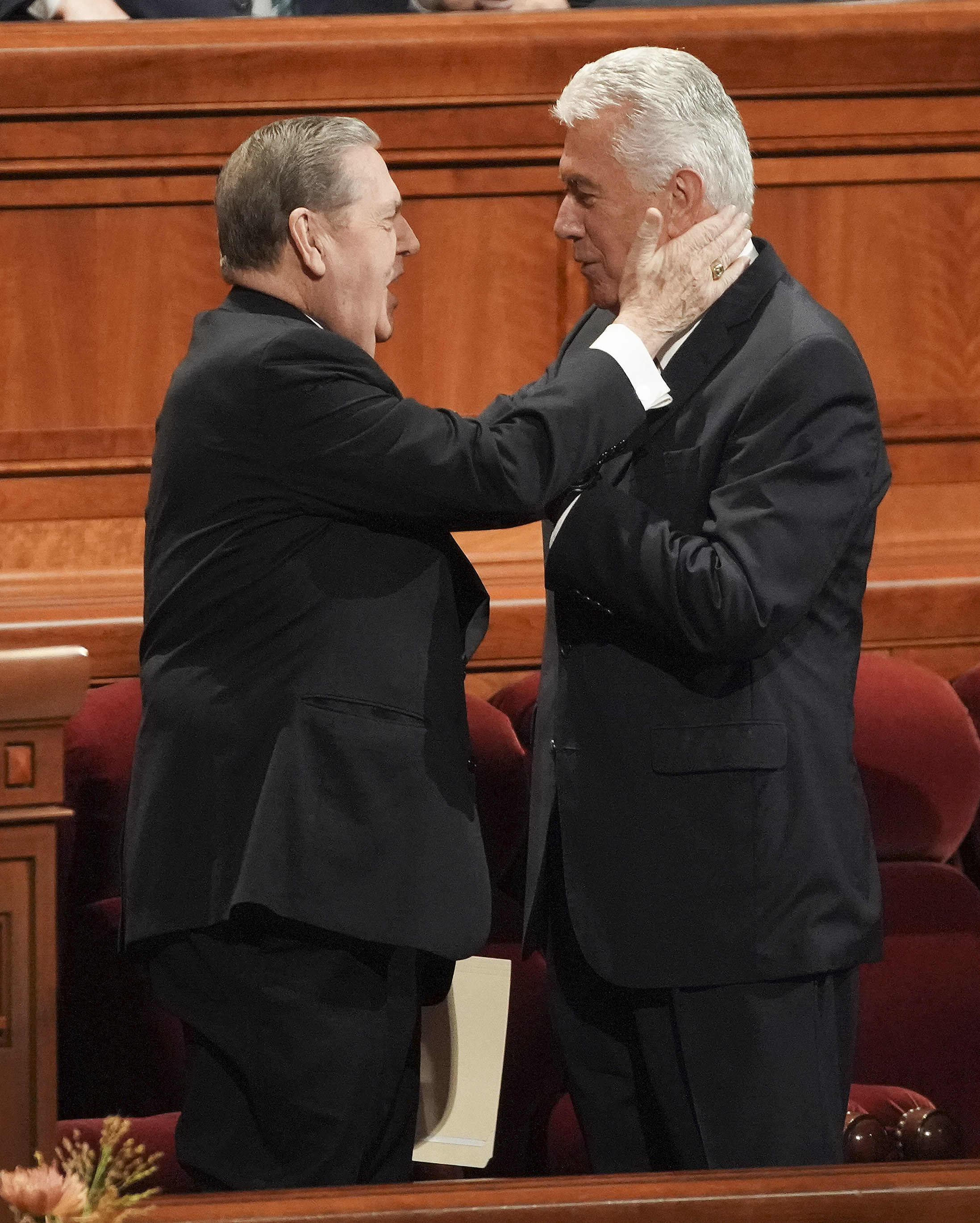Elder Jeffrey R. Holland, left, and Elder Dieter F. Uchtdorf, of the Quorum of the Twelve Apostles, greet prior to the Saturday morning session of the 189th Semiannual General Conference of The Church of Jesus Christ of Latter-day Saints in the Conference Center in Salt Lake City on Saturday, Oct. 5, 2019.