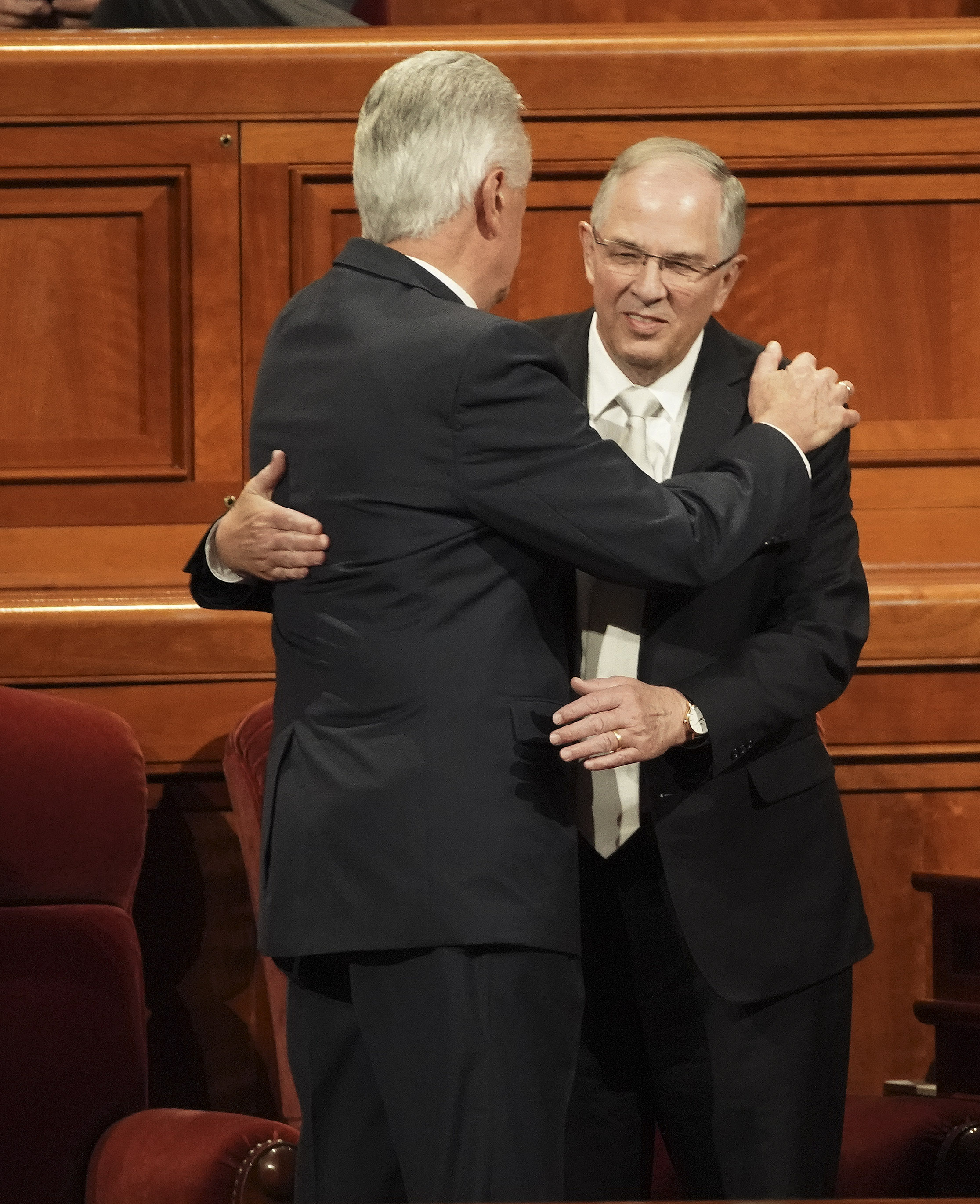 Elder Dieter F. Uchtdorf and Elder Neil L. Andersen of the Quorum of the Twelve Apostles, hug prior to the Saturday afternoon session of the 189th Semiannual General Conference of The Church of Jesus Christ of Latter-day Saints in the Conference Center in Salt Lake City on Saturday, Oct. 5, 2019.