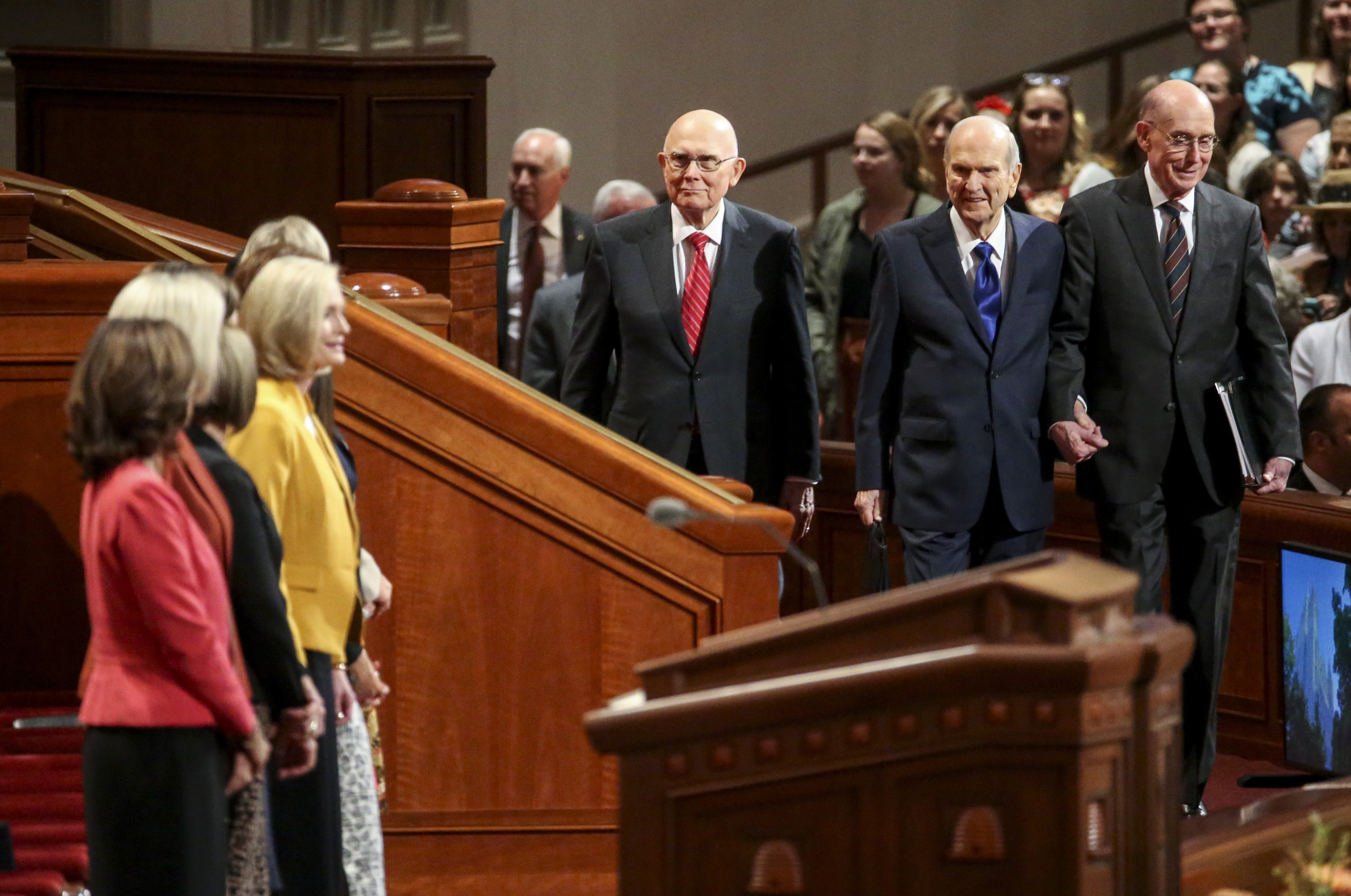 President Russell M. Nelson, center, walks into the Conference Center with President Henry B. Eyring, second counselor in the First Presidency, right, and President Dallin H. Oaks, first counselor in the First Presidency, before the general women's session of the 189th Semiannual General Conference of The Church of Jesus Christ of Latter-day Saints in the Conference Center in Salt Lake City on Saturday, Oct. 5, 2019.