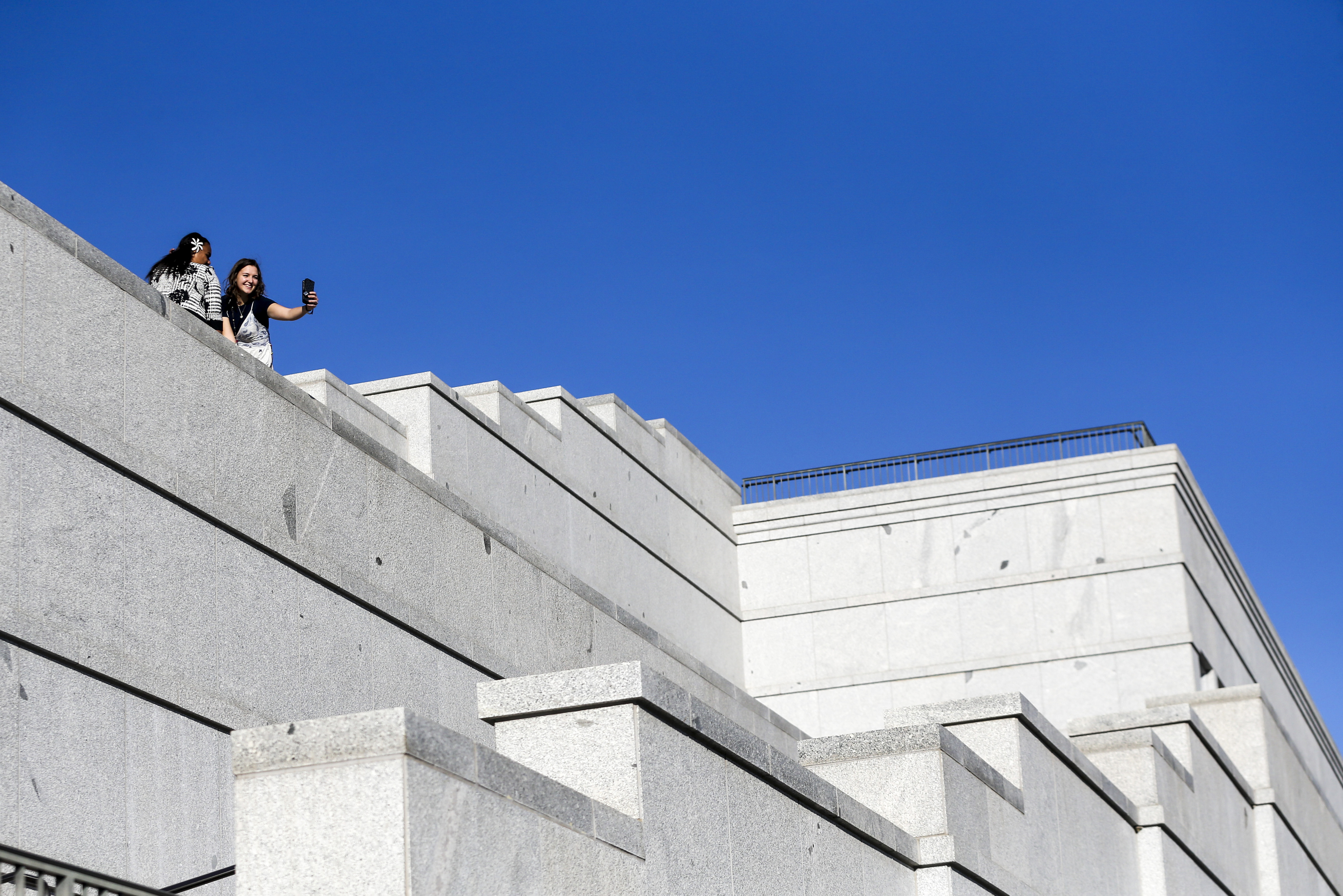 Joana Taufanga, of Tonga, left, and Sarah Meyer, of Canada, take a selfie from the upper level of the Conference Center before the general women's session of the 189th Semiannual General Conference of The Church of Jesus Christ of Latter-day Saints in the Conference Center in Salt Lake City on Saturday, Oct. 5, 2019. The duo met each other during an 18-month mission in Vanuatu, and this was their first chance to spend time together since their mission ended.