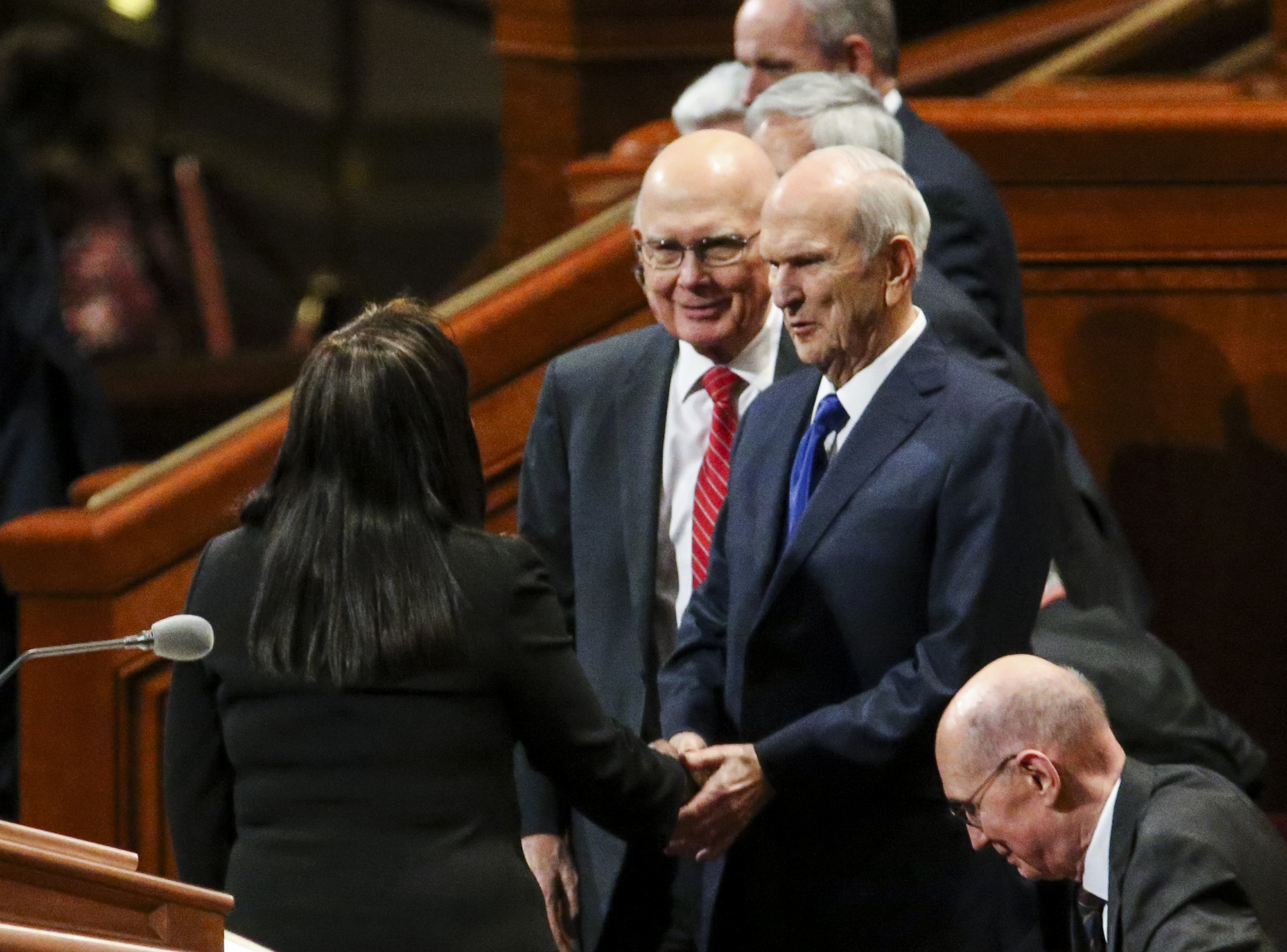 President Russell M. Nelson shakes Carol Costley's hand at the end of the women's session of the 189th Semiannual General Conference of The Church of Jesus Christ of Latter-day Saints, with President Dallin H. Oaks, first counselor in the First Presidency, on the right, at the Conference Center in Salt Lake City on Saturday, Oct. 5, 2019.