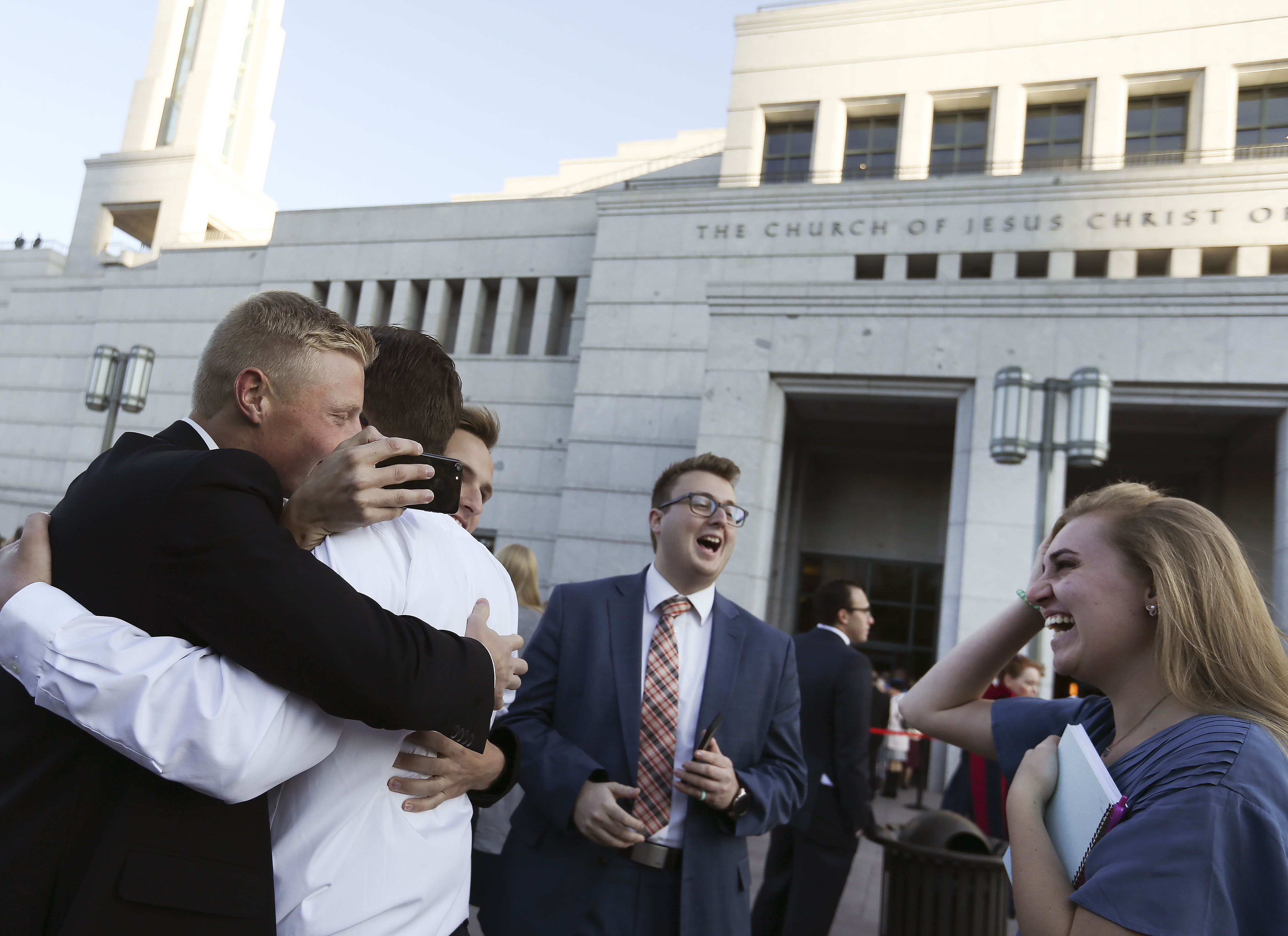 Friends greet one another before the Sunday morning session of the 189th Semiannual General Conference of The Church of Jesus Christ of Latter-day Saints at the Conference Center in Salt Lake City on Sunday, Oct. 6, 2019.