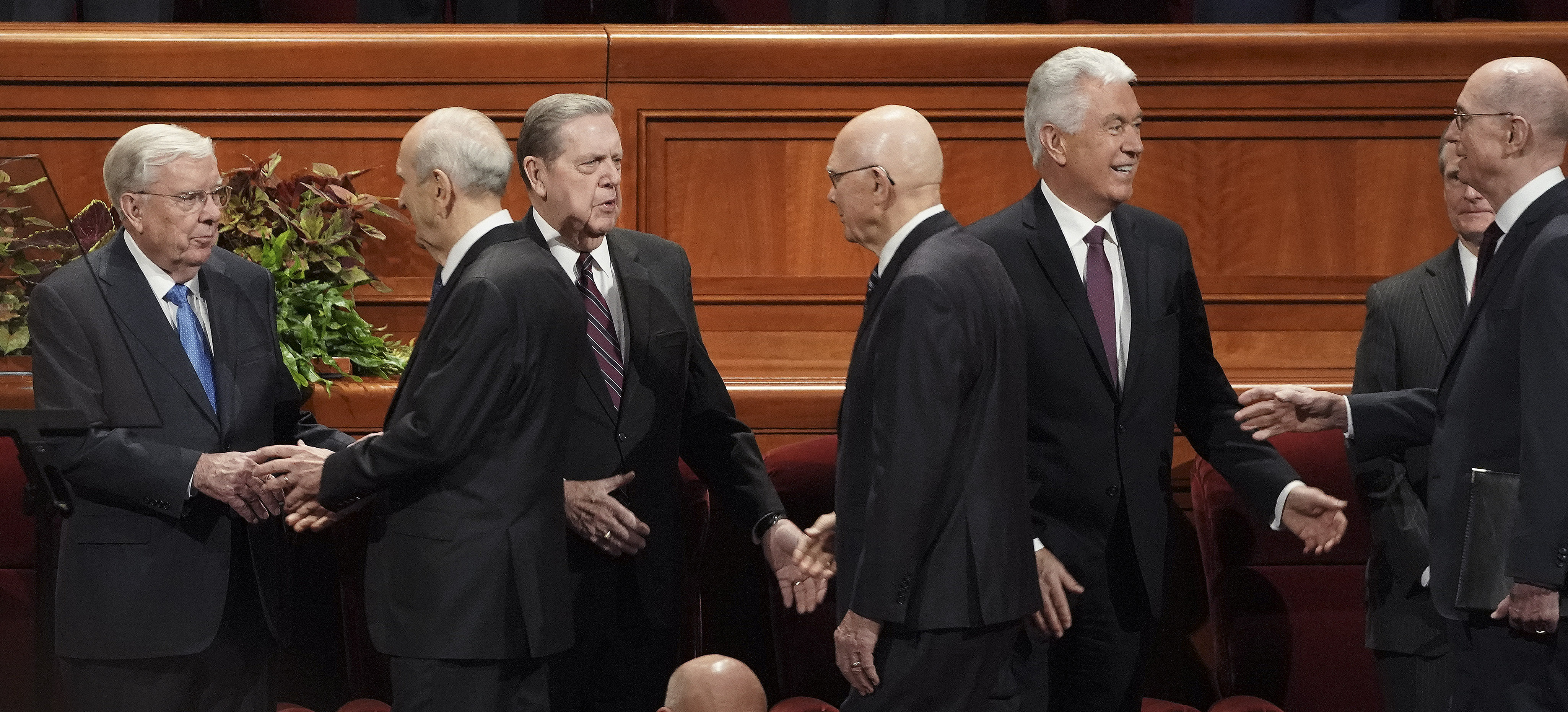 President Russell M. Nelson, left, and his counselors, President Dallin H. Oaks, first counselor in the First Presidency, center, and President Henry B. Eyring, second counselor in the First Presidency, right, greet fellow general authorities before the Sunday morning session of the 189th Semiannual General Conference of The Church of Jesus Christ of Latter-day Saints in the Conference Center in Salt Lake City on Sunday, Oct. 6, 2019.