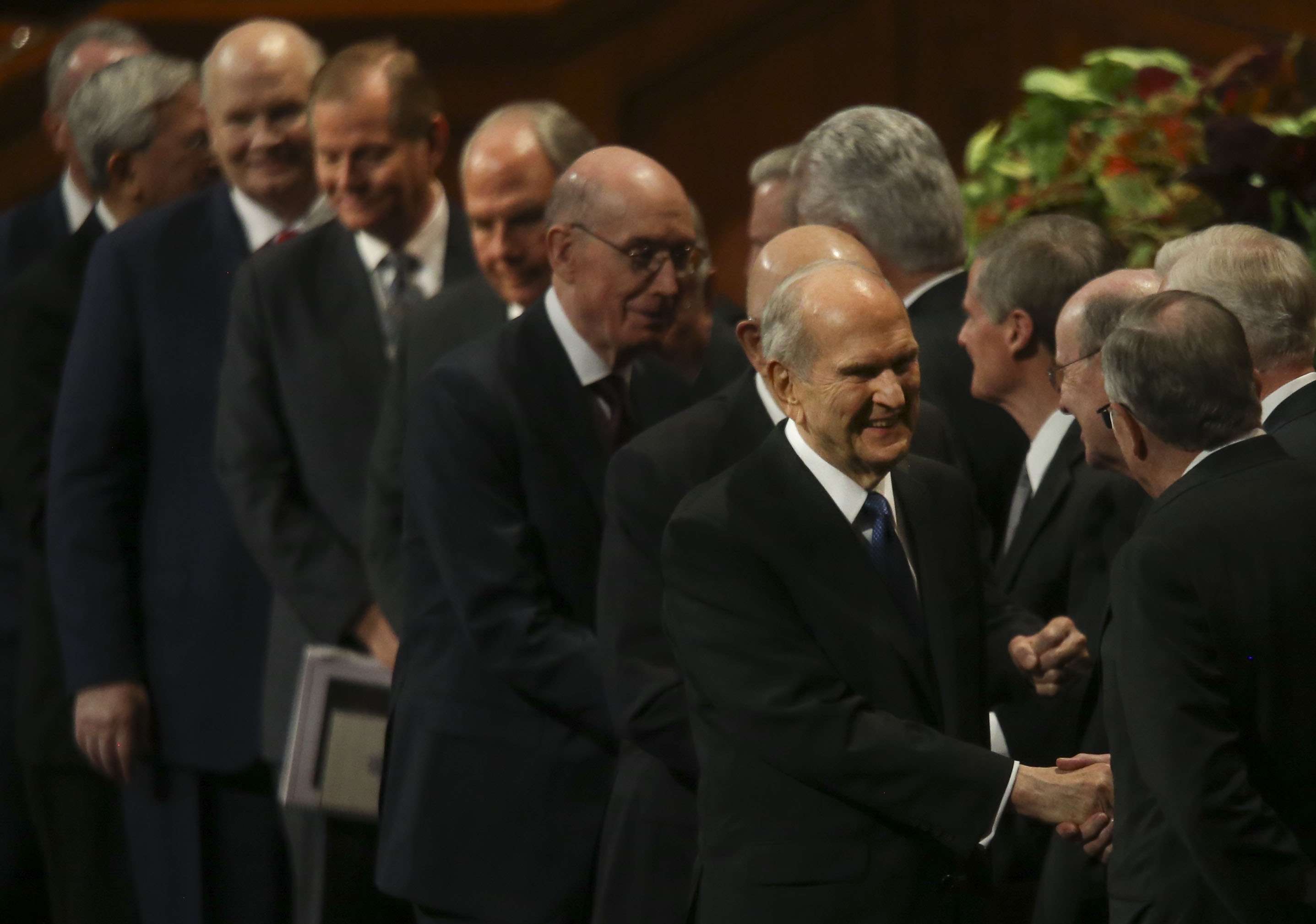 President Russell M. Nelson shakes hands with general authorities after the Sunday morning session of the 189th Semiannual General Conference of The Church of Jesus Christ of Latter-day Saints at the Conference Center in Salt Lake City on Sunday, Oct. 6, 2019.