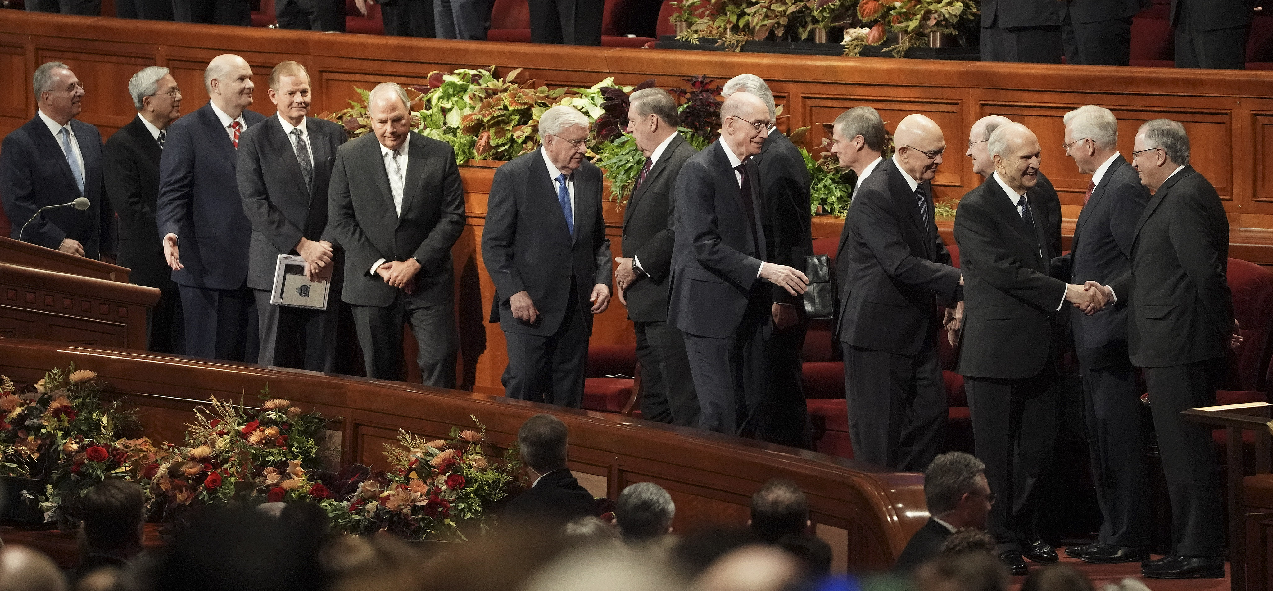 President Russell M. Nelson shackles hands with general authorities after the Sunday morning session of the 189th Semiannual General Conference of The Church of Jesus Christ of Latter-day Saints in Salt Lake City on Sunday, Oct. 6, 2019.