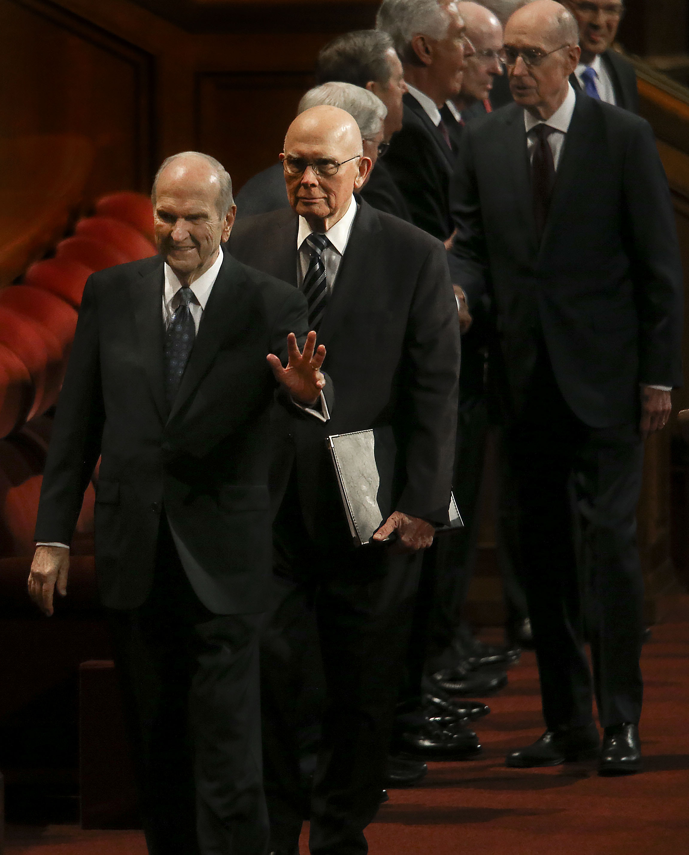 President Russell M. Nelson, of The Church of Jesus Christ of Latter-day Saints, front, and his counselors, President Dallin H. Oaks, first counselor in the First Presidency, and President Henry B. Eyring, second counselor in the First Presidency, enter the Conference Center for the Sunday afternoon session of general conference in the Conference Center in Salt Lake City on Sunday, Oct. 6, 2019.