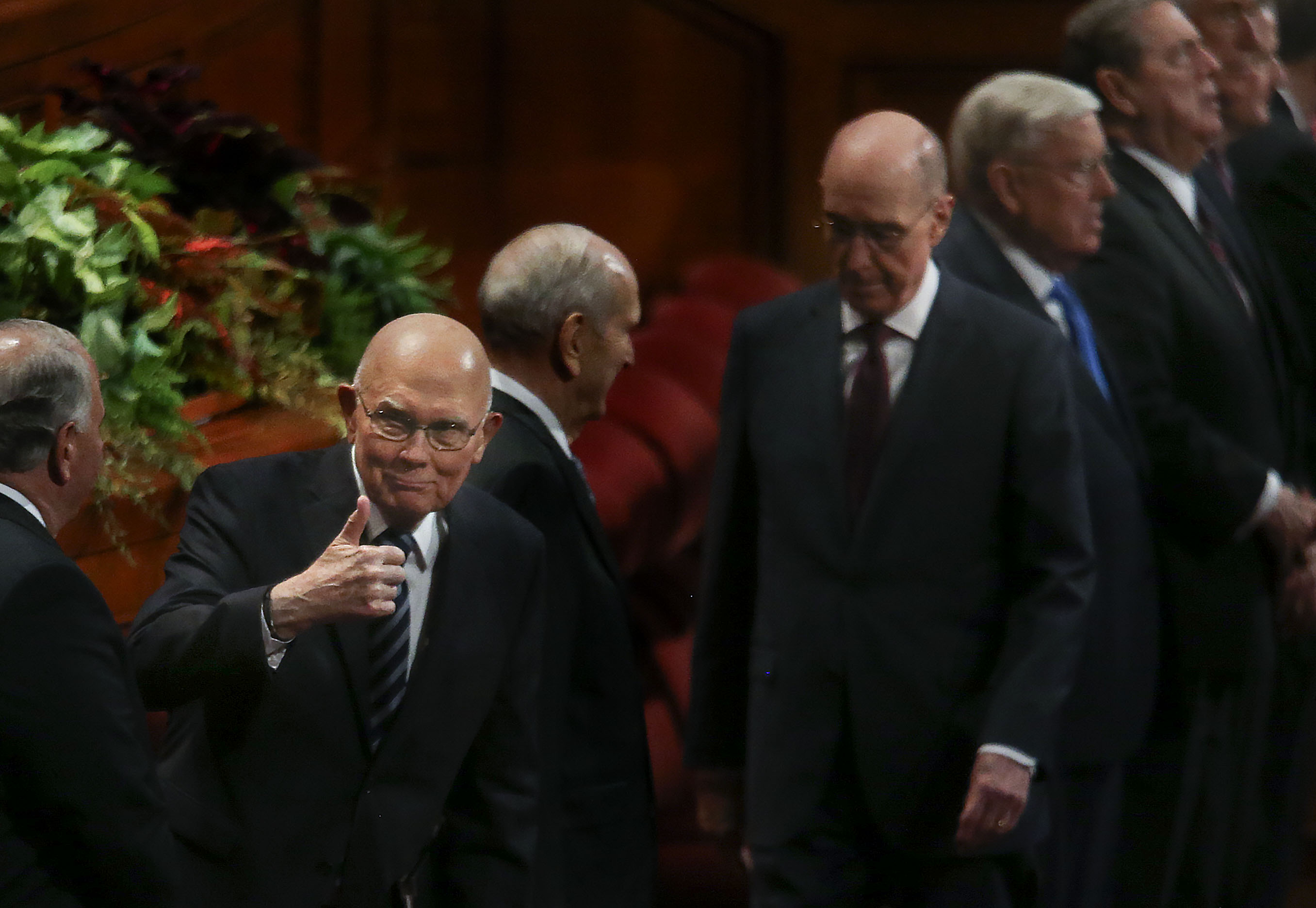 President Dallin H. Oaks, first counselor in the First Presidency of The Church of Jesus Christ of Latter-day Saints, gives a thumbs-up to church leaders as they enter the Conference Center for the Sunday afternoon session of the 189th Semiannual General Conference of The Church of Jesus Christ of Latter-day Saints in Salt Lake City on Sunday, Oct. 6, 2019.