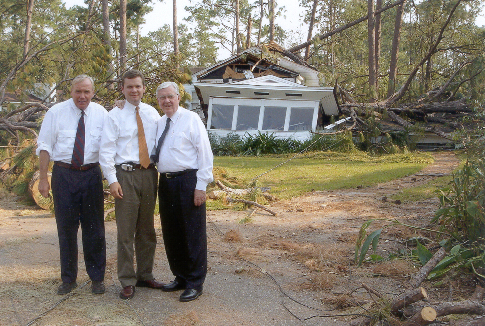 Elder Jon M. Huntsman Sr., Peter Huntsman and Elder M. Russell Ballard survey some of the damage in Hattiesburg, Mississippi, Sept. 4, 2005.