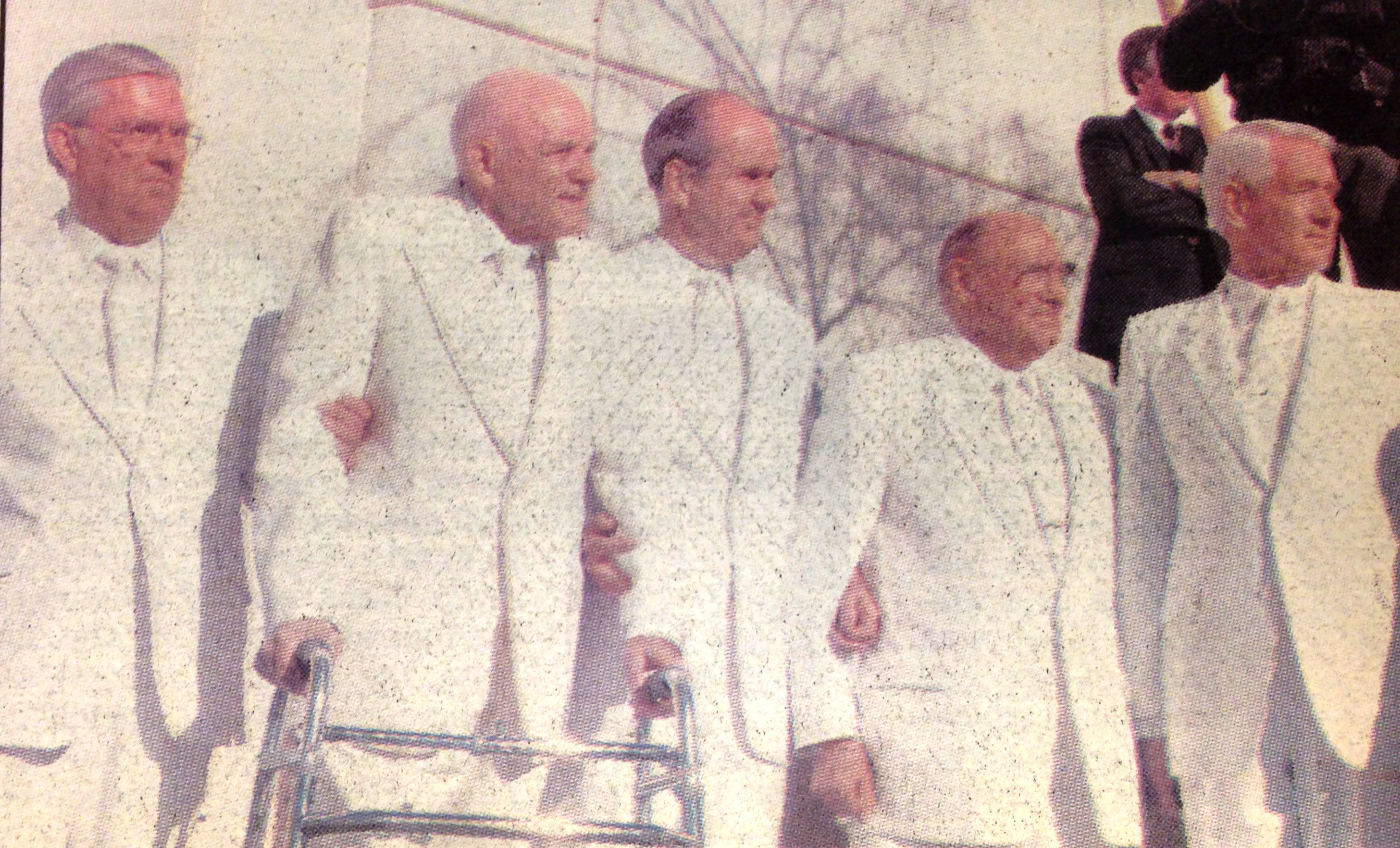 Elder Dean L. Larsen, right end, stands with Elder M. Russell Ballard, left end, President Howard W. Hunter, and Elders Russell M. Nelson and Joseph B. Wirthlin to watch the cornerstone laying at the dedication of the Las Vegas Temple in 1989.