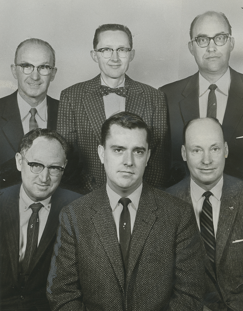 M. Russell Ballard served twice as a bishop. Here he is pictured with the Holladay 12th Ward, Olympus Stake. Left to right are Glendon M. Whitmore, first counselor; Bishop M. Russell Ballard Jr., and Boyd N. Nielson, second counselor. At rear are Irvan W. McCarrel, J. Rodney Taylor and H. Clive Kimball, clerks.