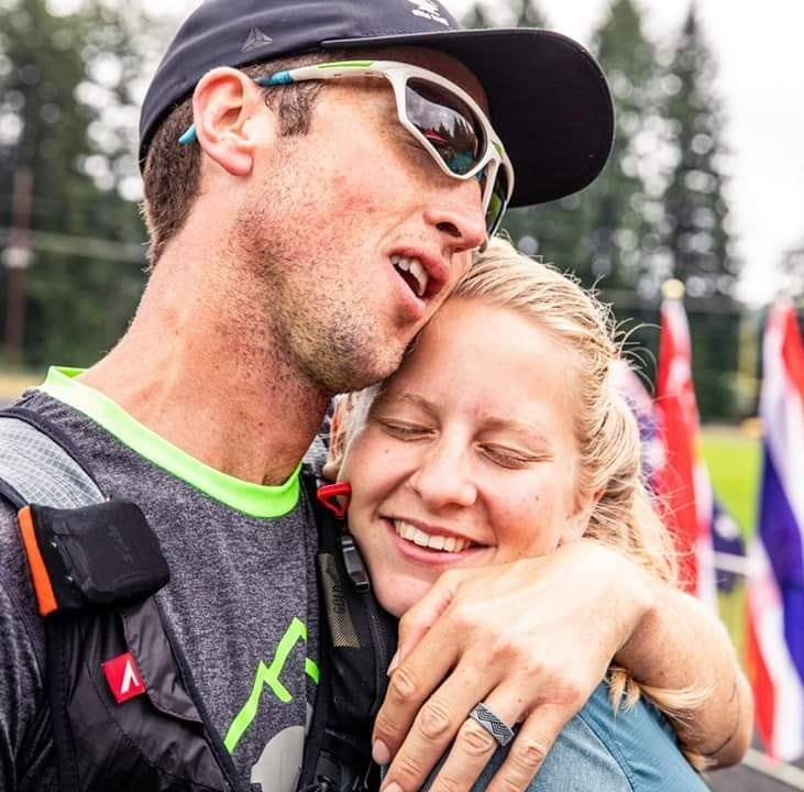 Ultramarathoner Michael McKnight hugs his wife, Sarah McKnight at the finish line of one of more than 40 ultramarathons he has run.