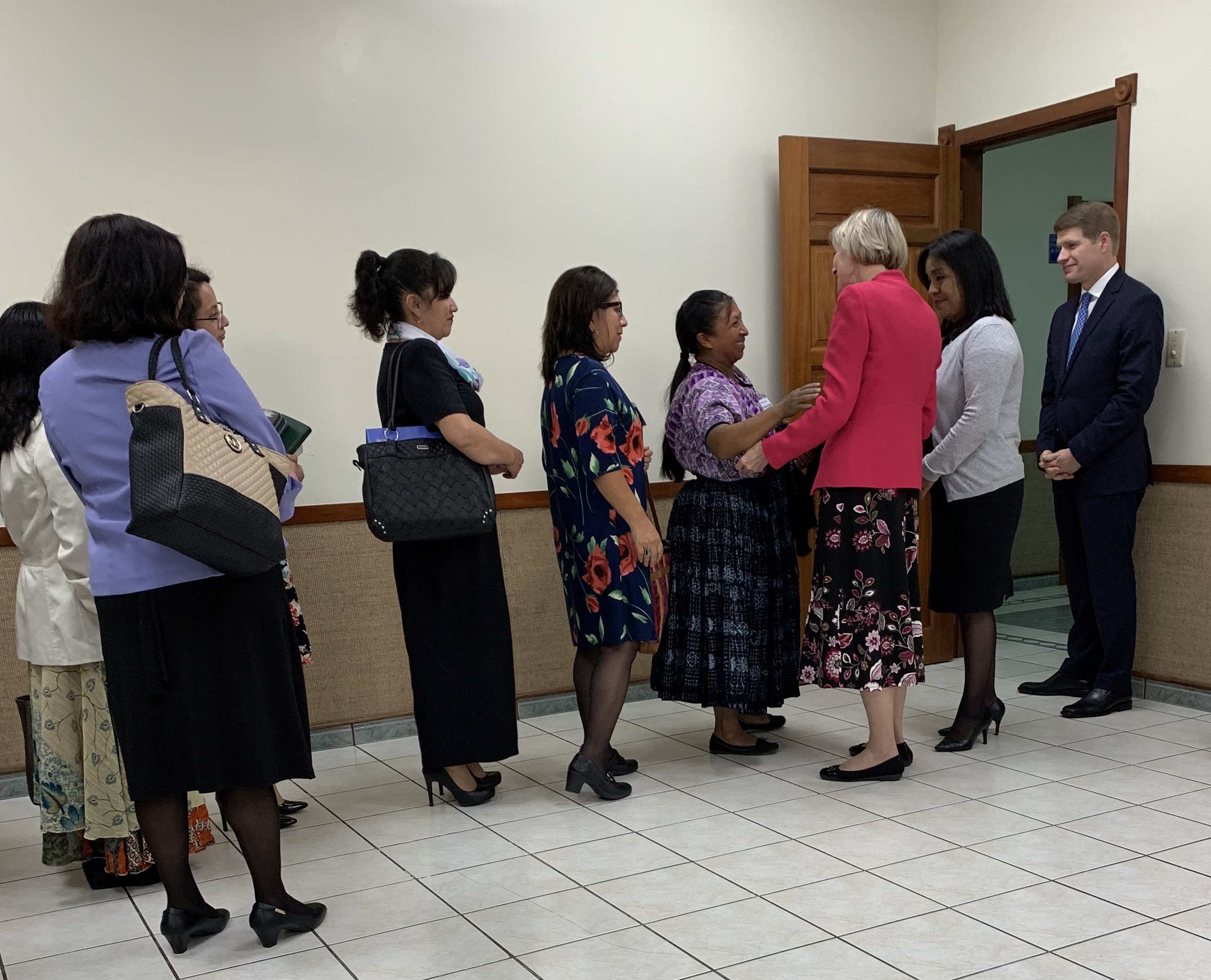 Sister Jean B. Bingham greets members in Central America during a recent ministering trip to the area in September 2019.
