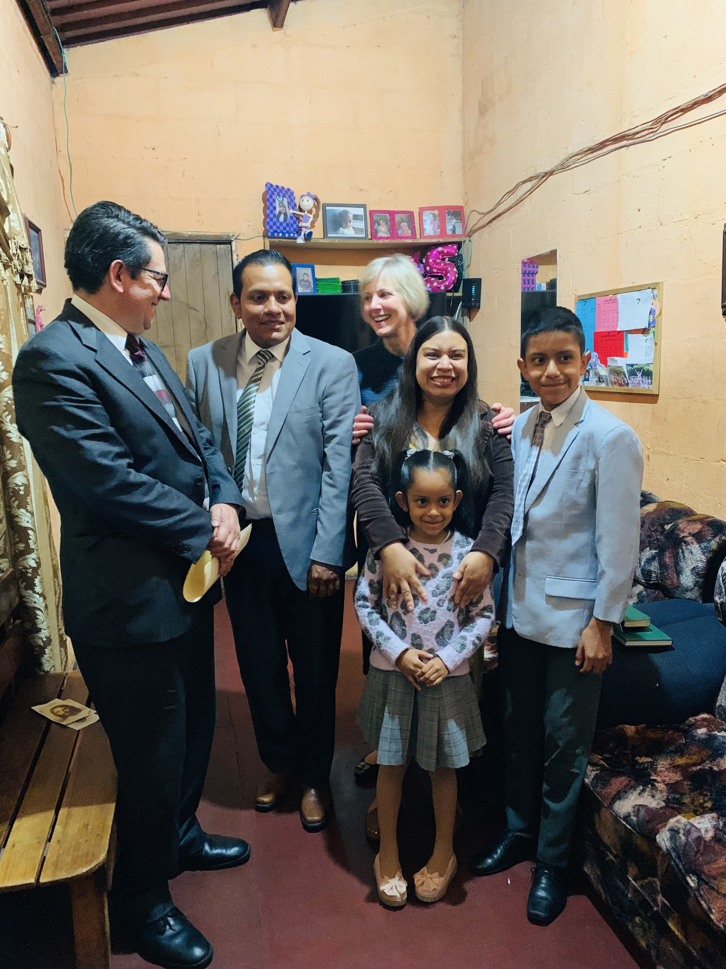 Sister Jean B. Bingham visits with the Herrera Benites family in Antigua, Guatemala during a recent ministering trip to Central America in September 2019.