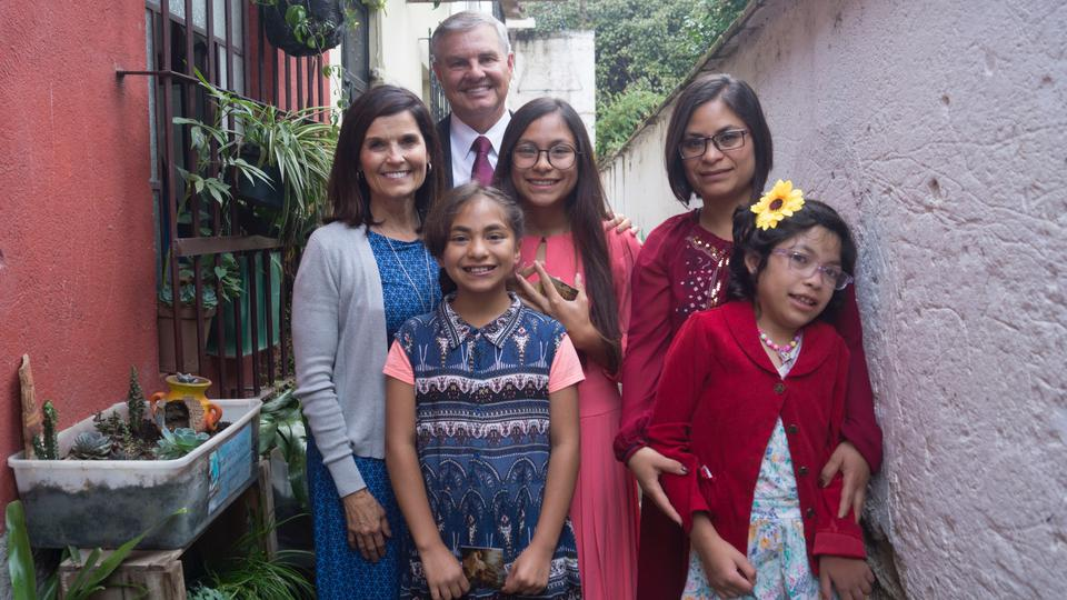 Sister Becky Craven and her husband, Ron Craven, visit with the Rodriguez family in Guatemala during a recent ministering trip to the country in September 2019.