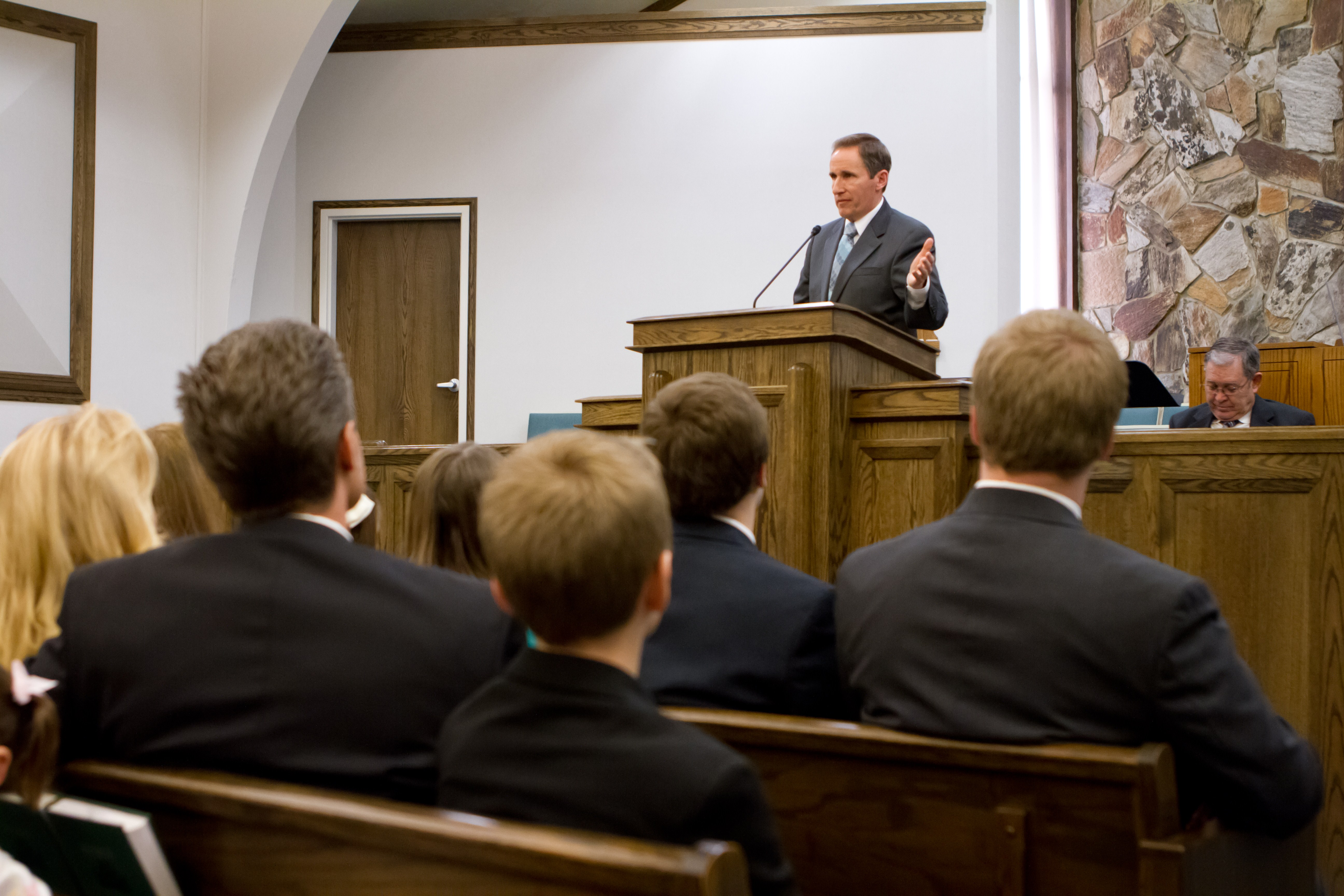 A Church member speaks in a Latter-day Saint chapel. The updated safety guidelines released on Oct. 10, 2019, encourage members to always be aware of their surroundings.