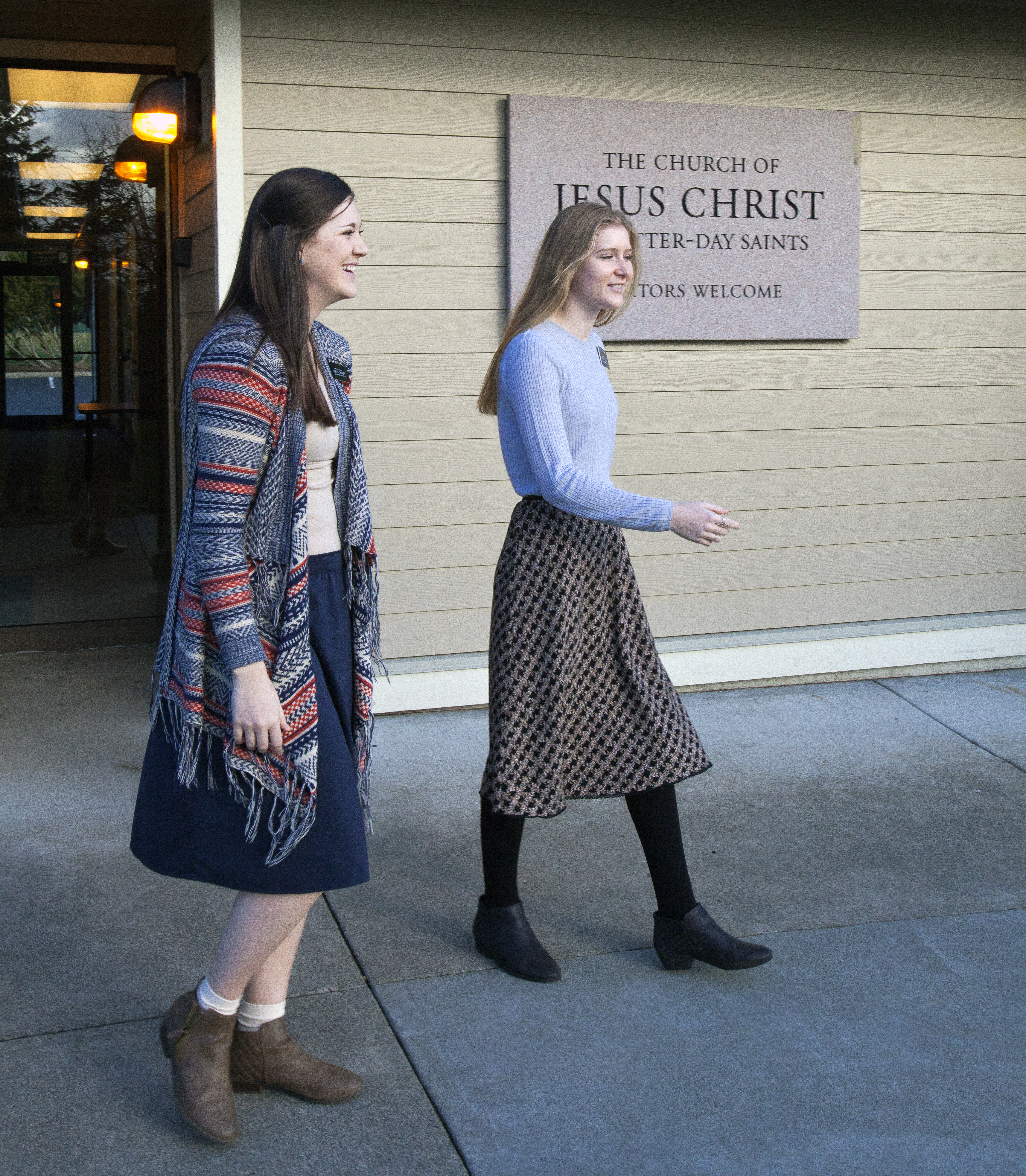 Young women exit a Latter-day Saint meetinghouse. The updated safety guidelines released on Oct. 10, 2019, encourage members to avoid being alone in Church buildings, especially women and youth.
