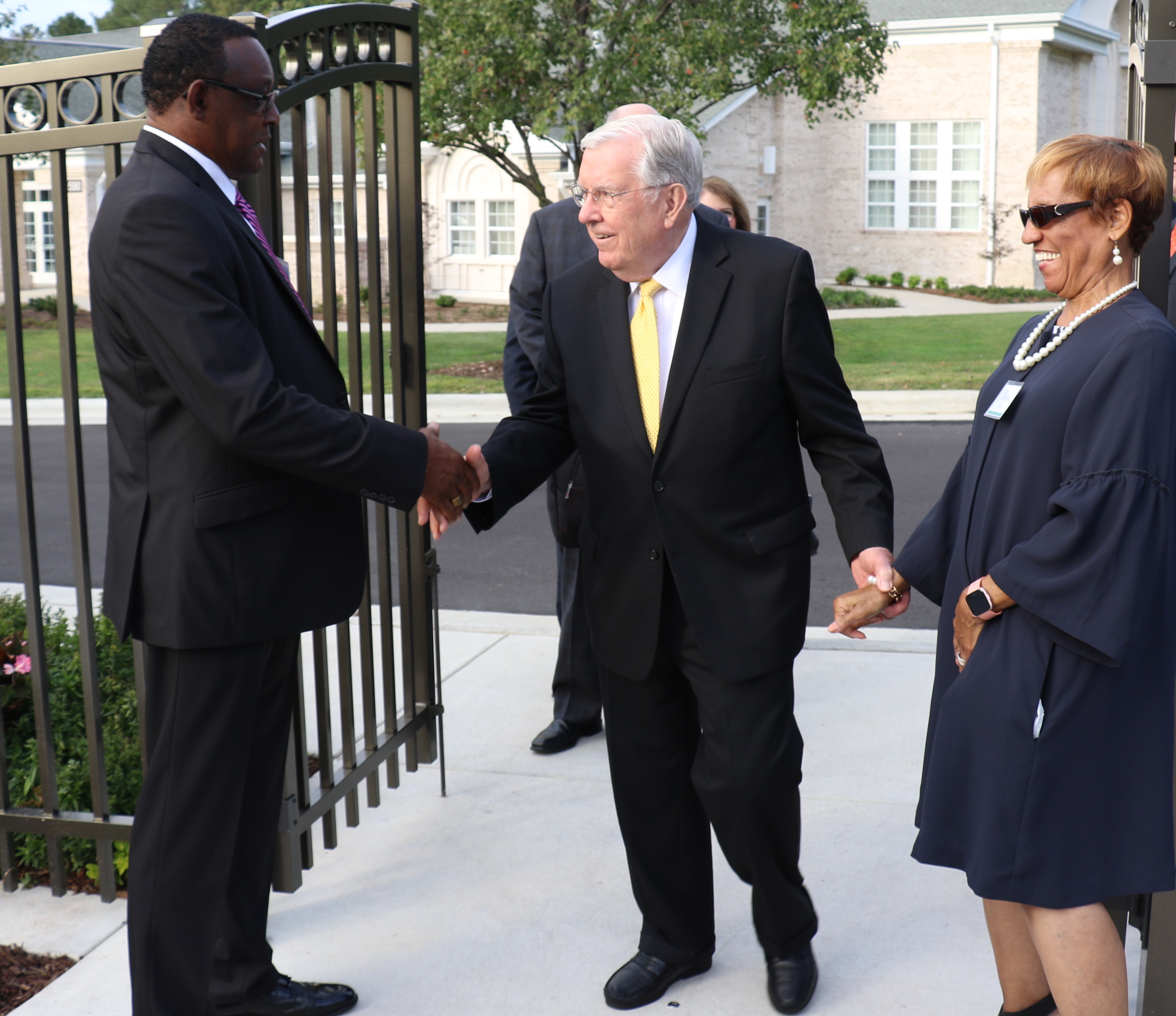 President M. Russell Ballard is greeted by ushers Willie and Pauline Brown outside the Raleigh North Carolina Temple on Oct. 13, 2019. President Ballard rededicated the temple after it was closed for refurbishing.