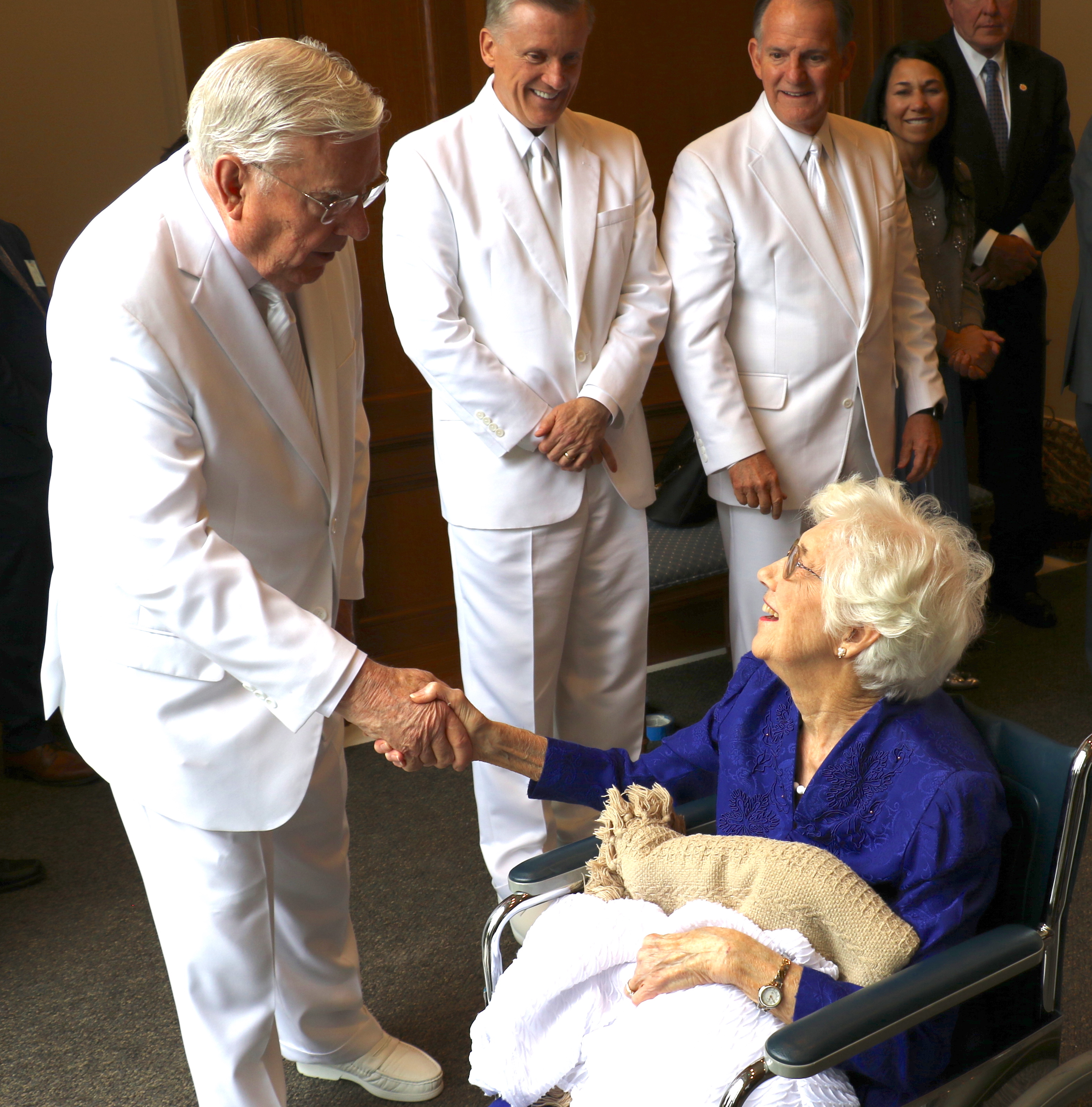 President M. Russell Ballard shakes hands with a North Carolina woman following the Oct. 13, 2019, rededication of the Raleigh North Carolina Temple. Elder Kevin R. Duncan and Elder James B. Martino are at right.